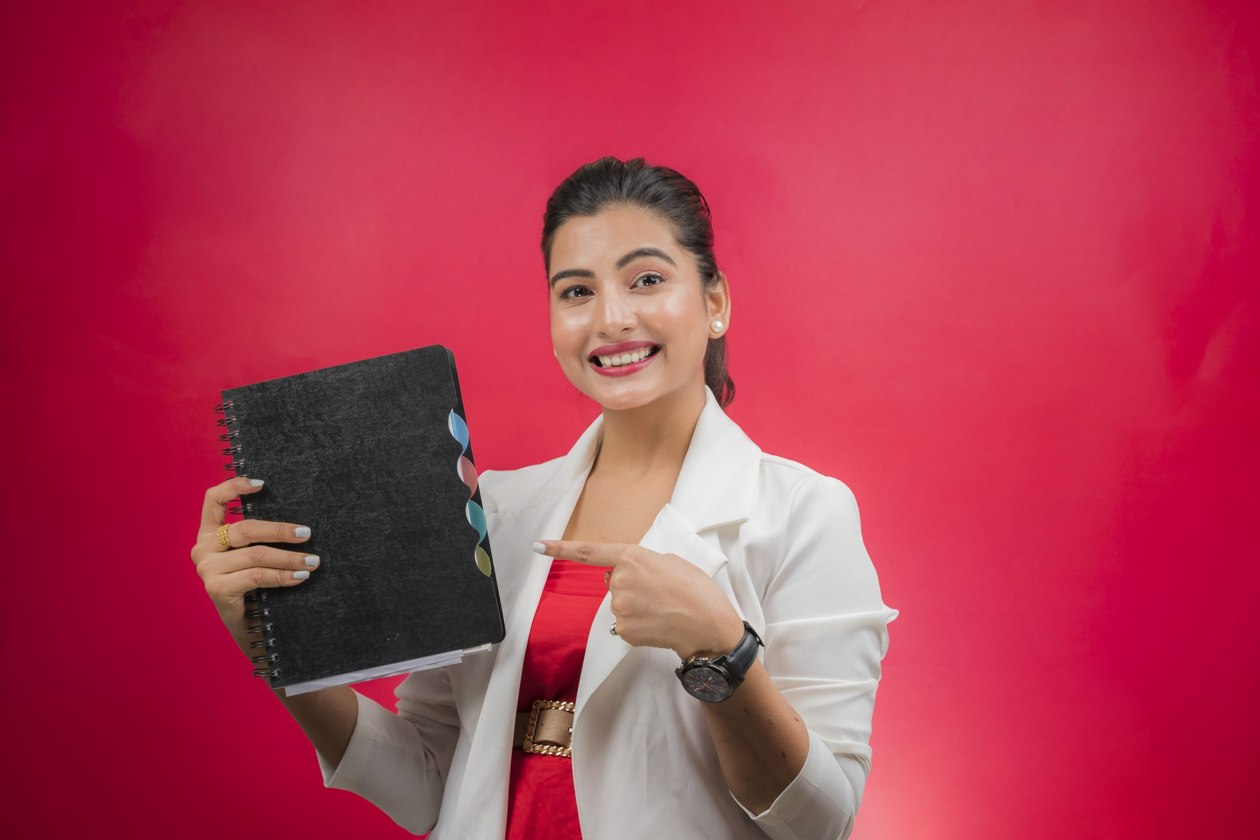 Indian girl pointing to Notebook