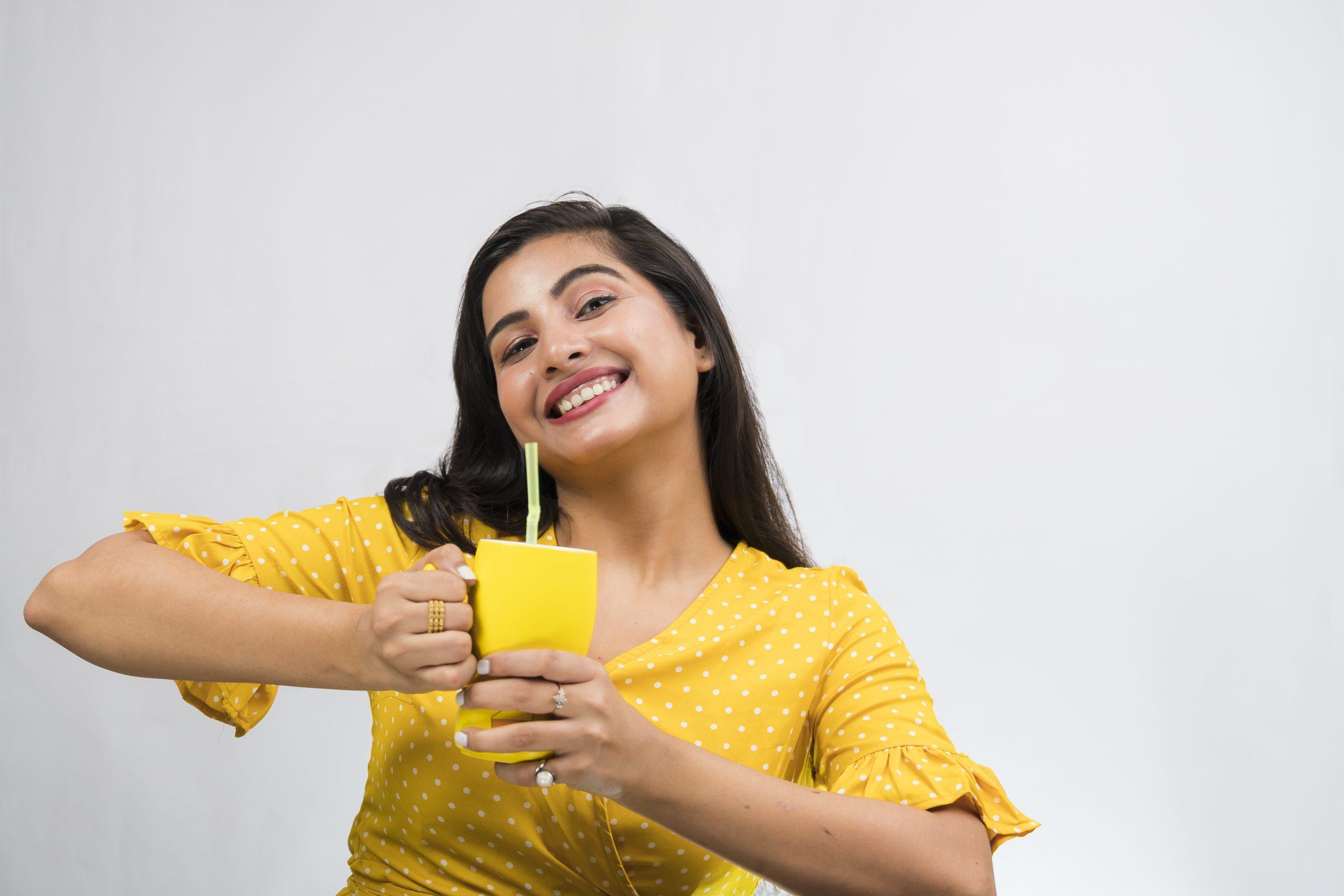 Indian girl posing with mug