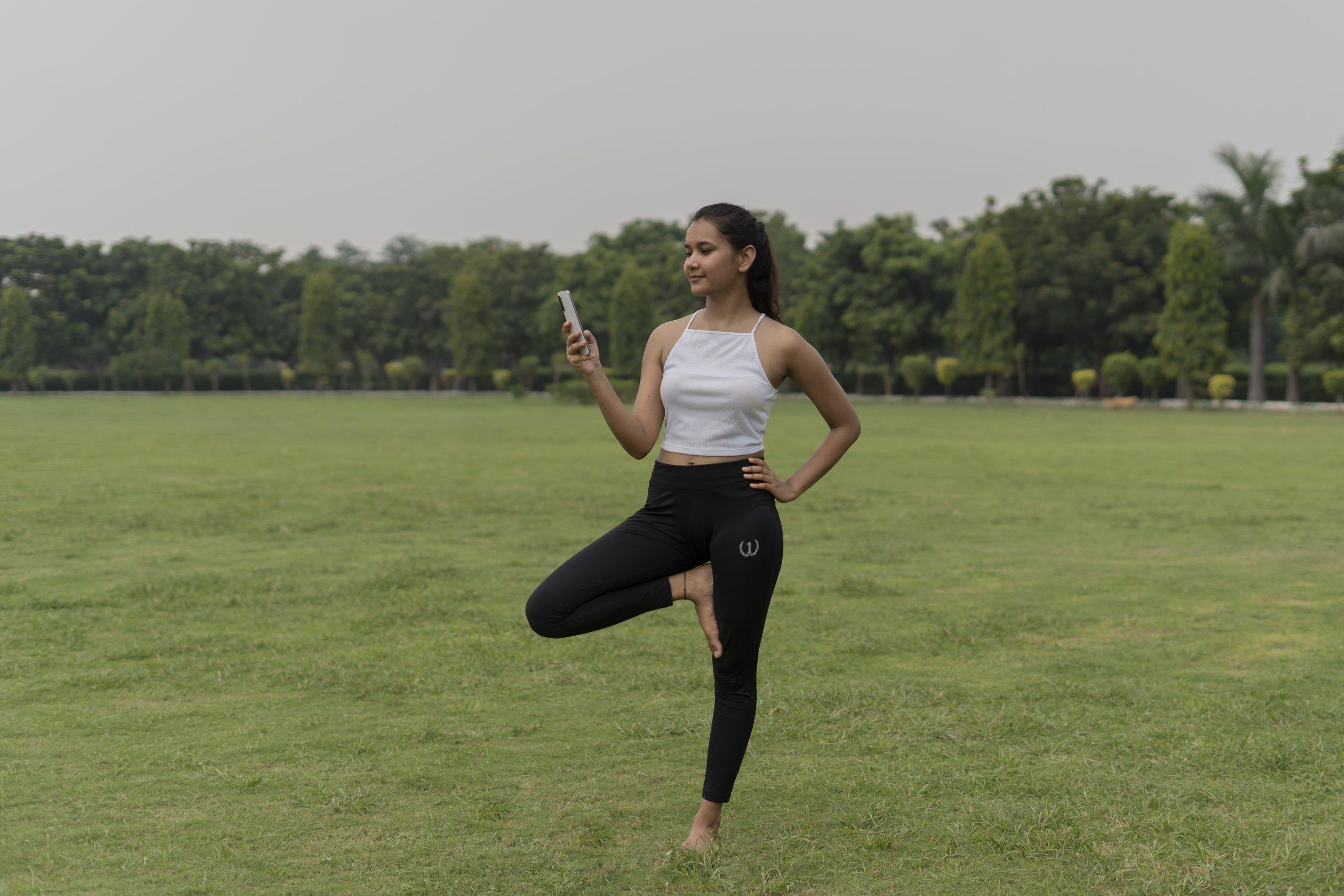 Girl Yoga With Phone