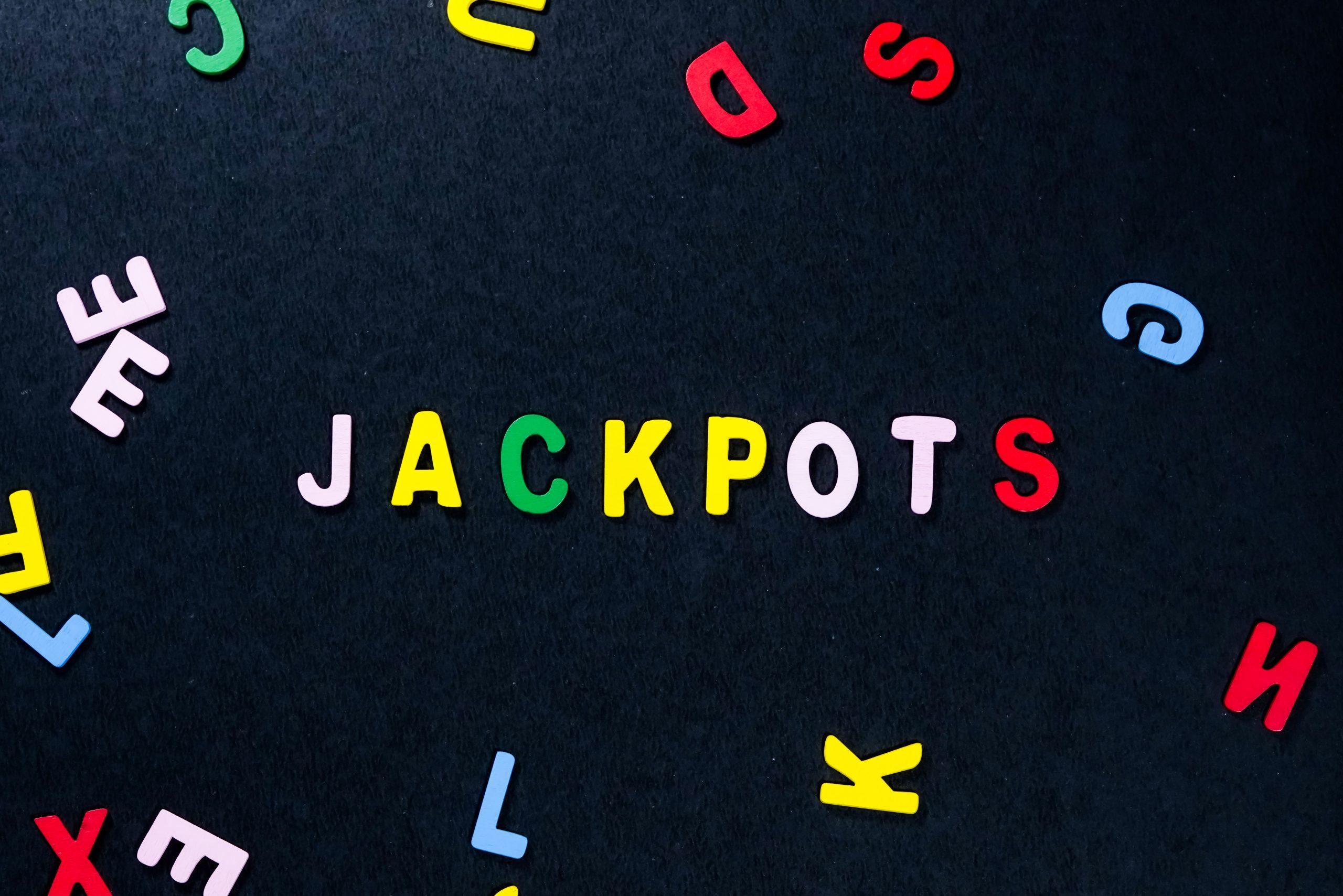 Jackpots written on scrabble