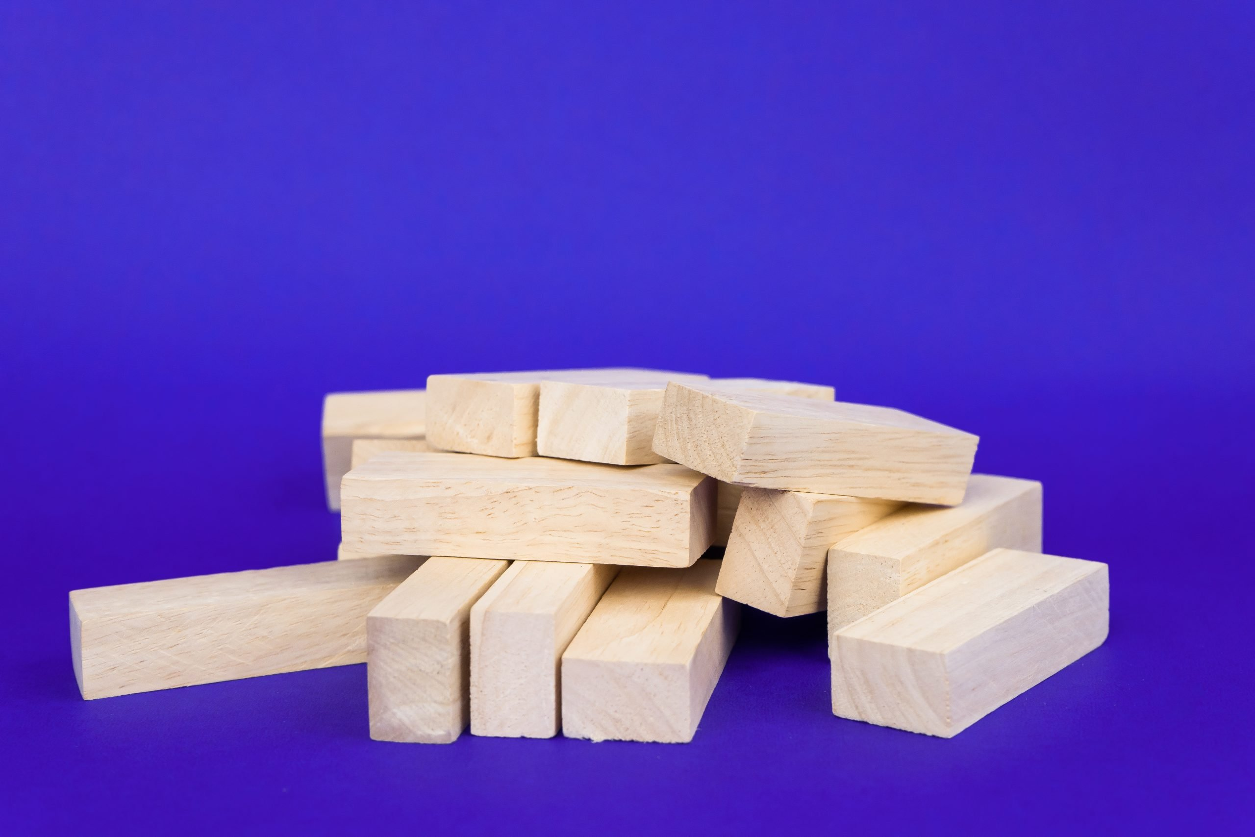 Jenga Pieces on Violet Background