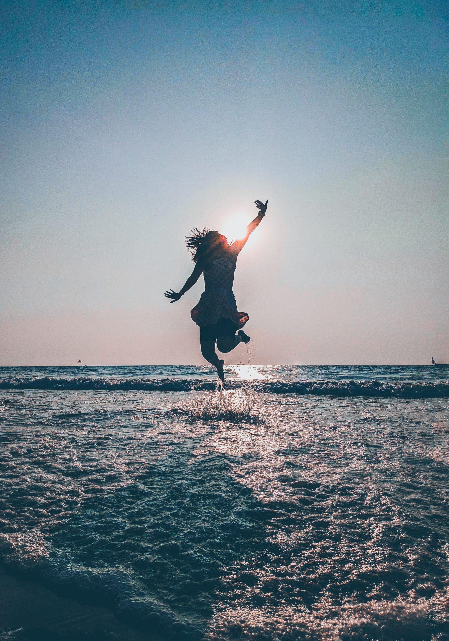 girl jumping in the sea