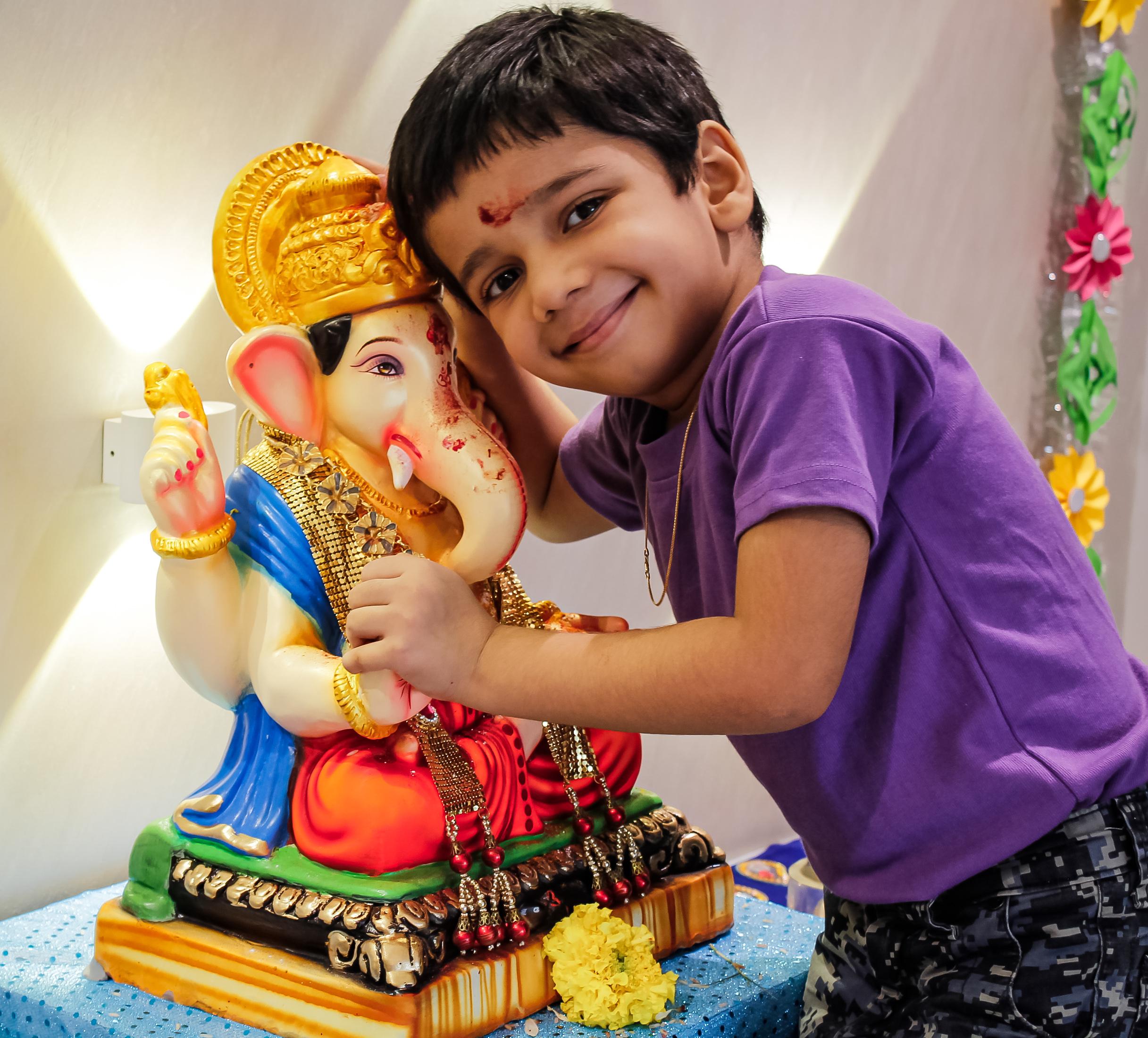 Kid with Lord Ganesha's Idol