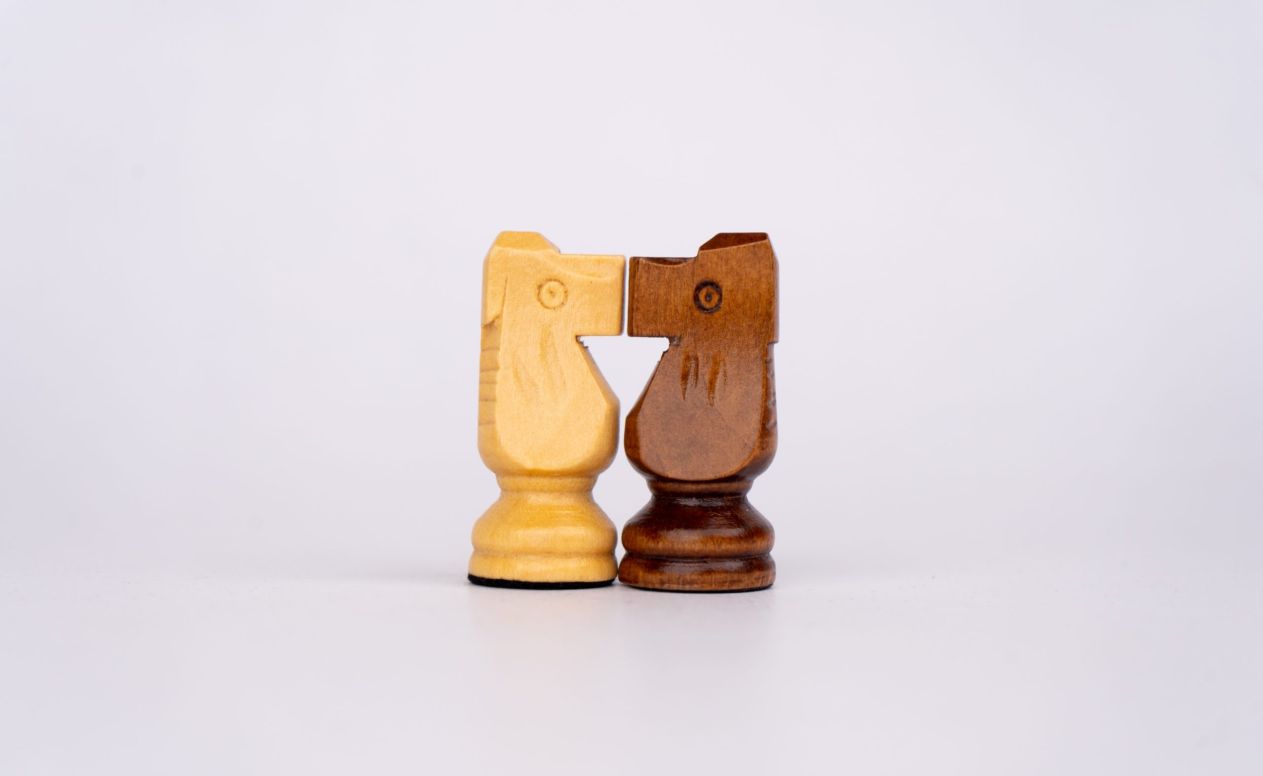 Knights chess piece standing close to each other