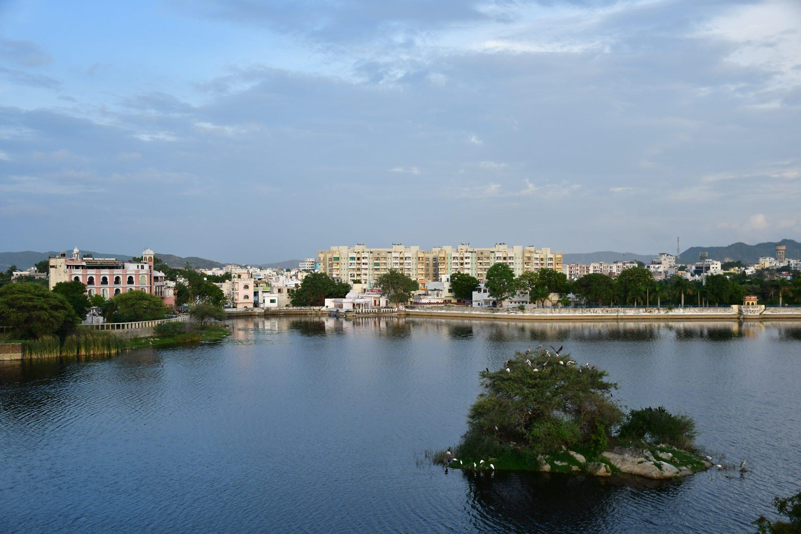 buildings alongside lake