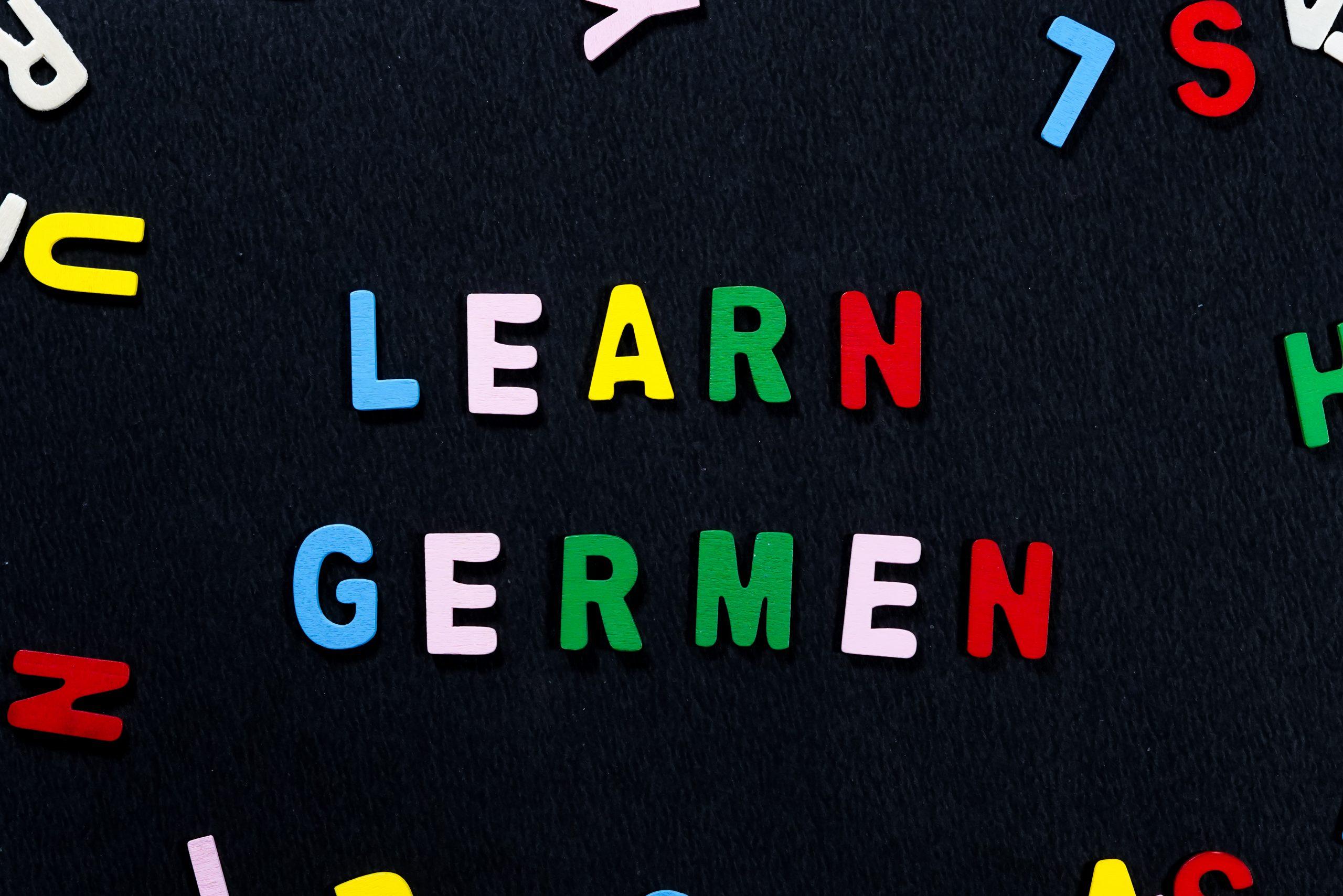 Learn German written with scrabble
