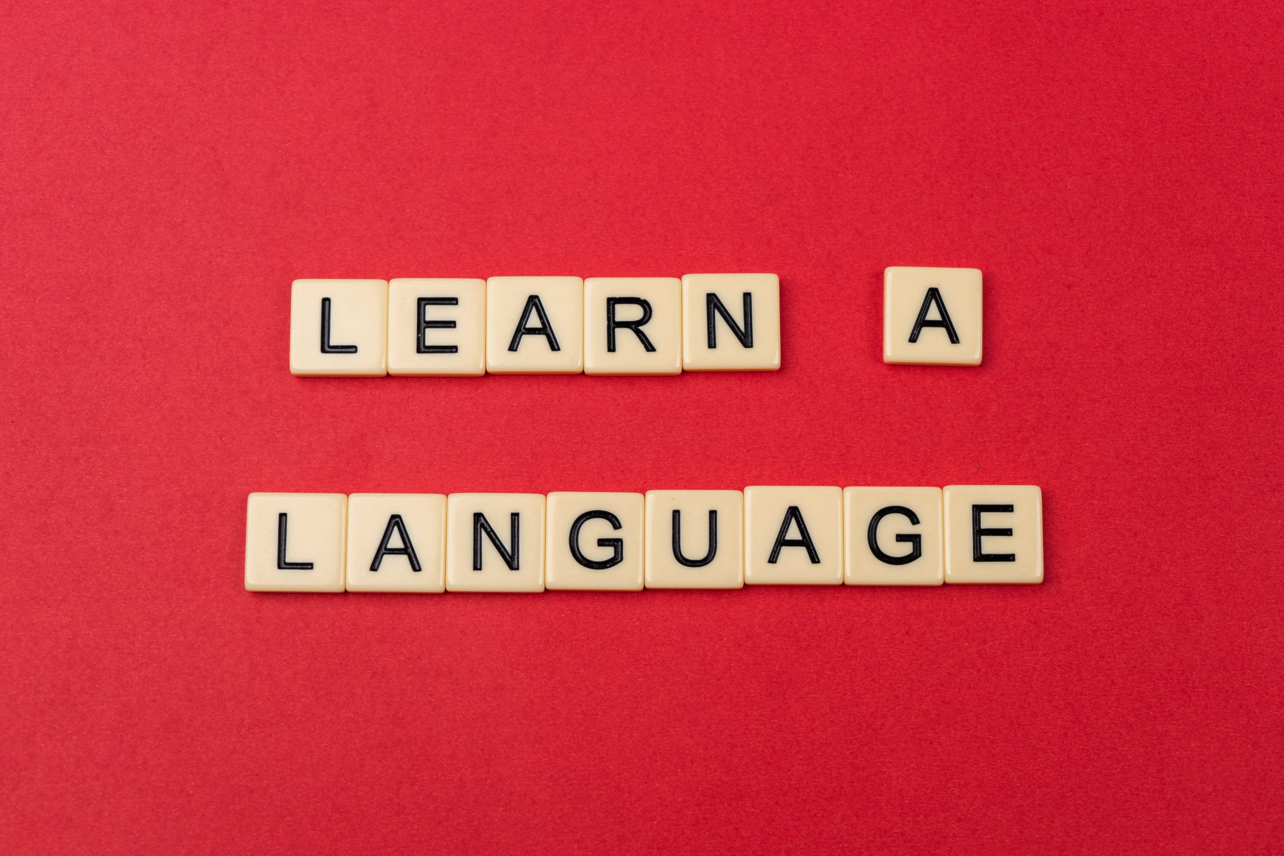 Learn a language written with scrabble