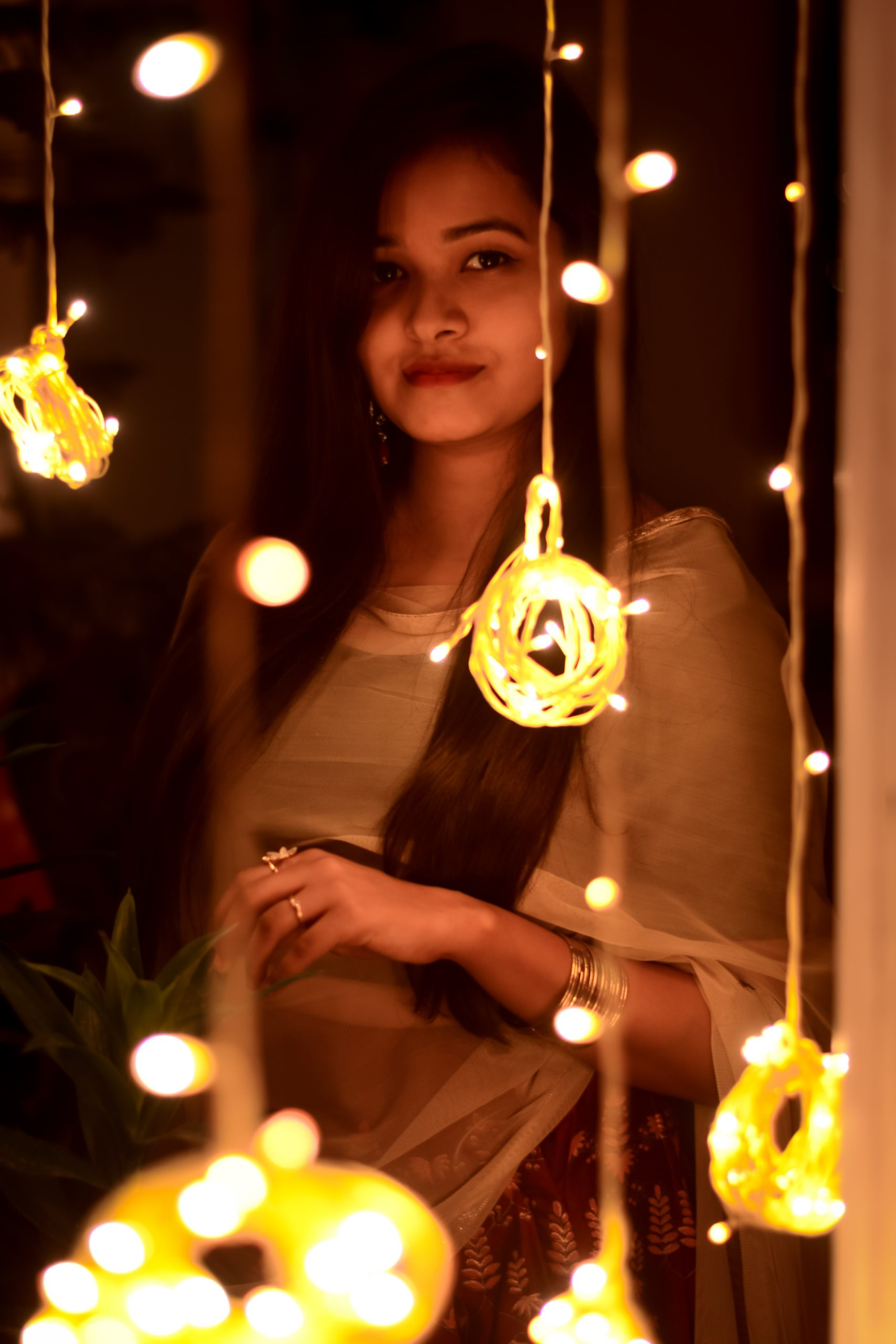 girl with fairy lights