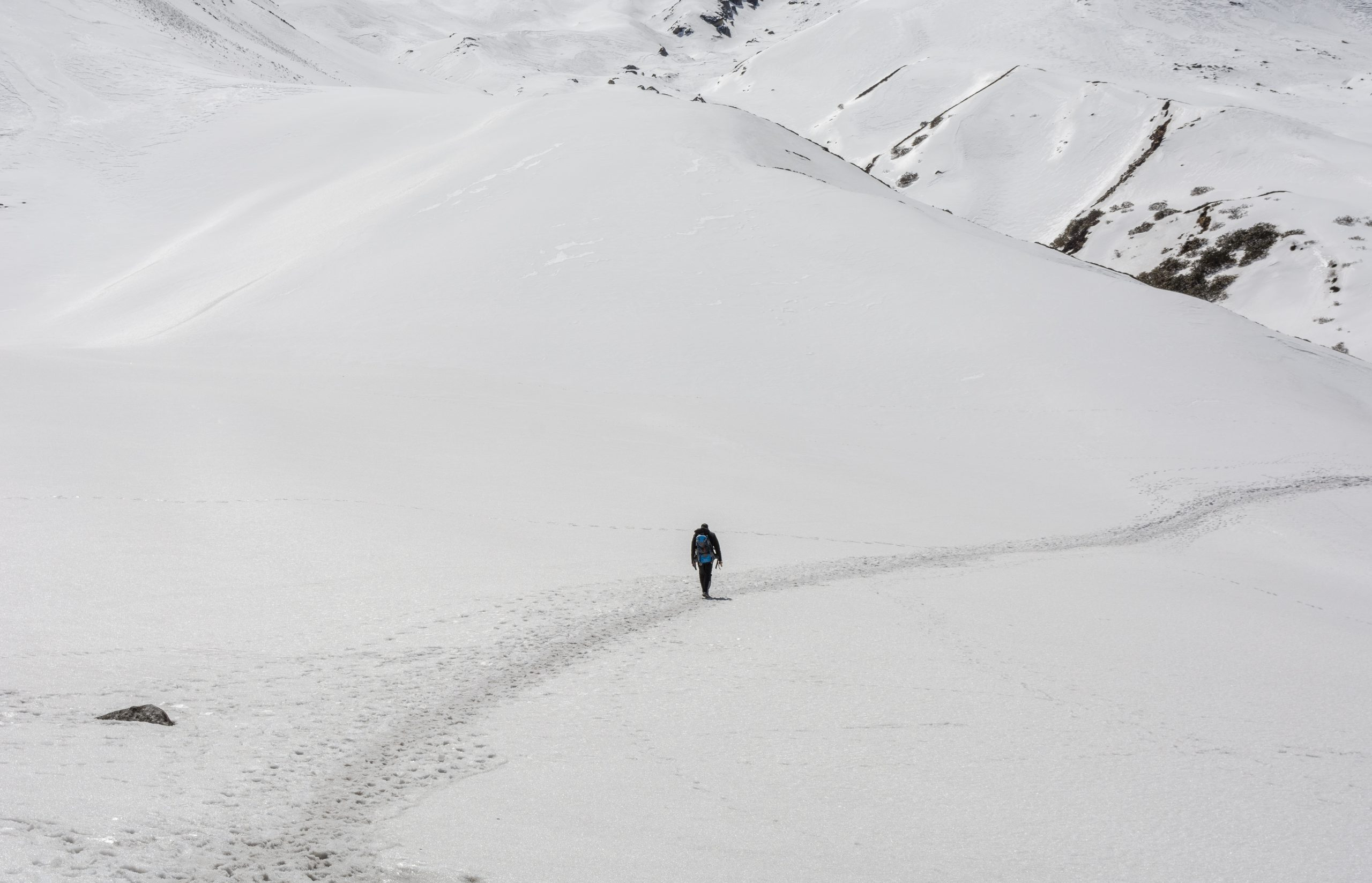 a person traveling alone in a snowy area