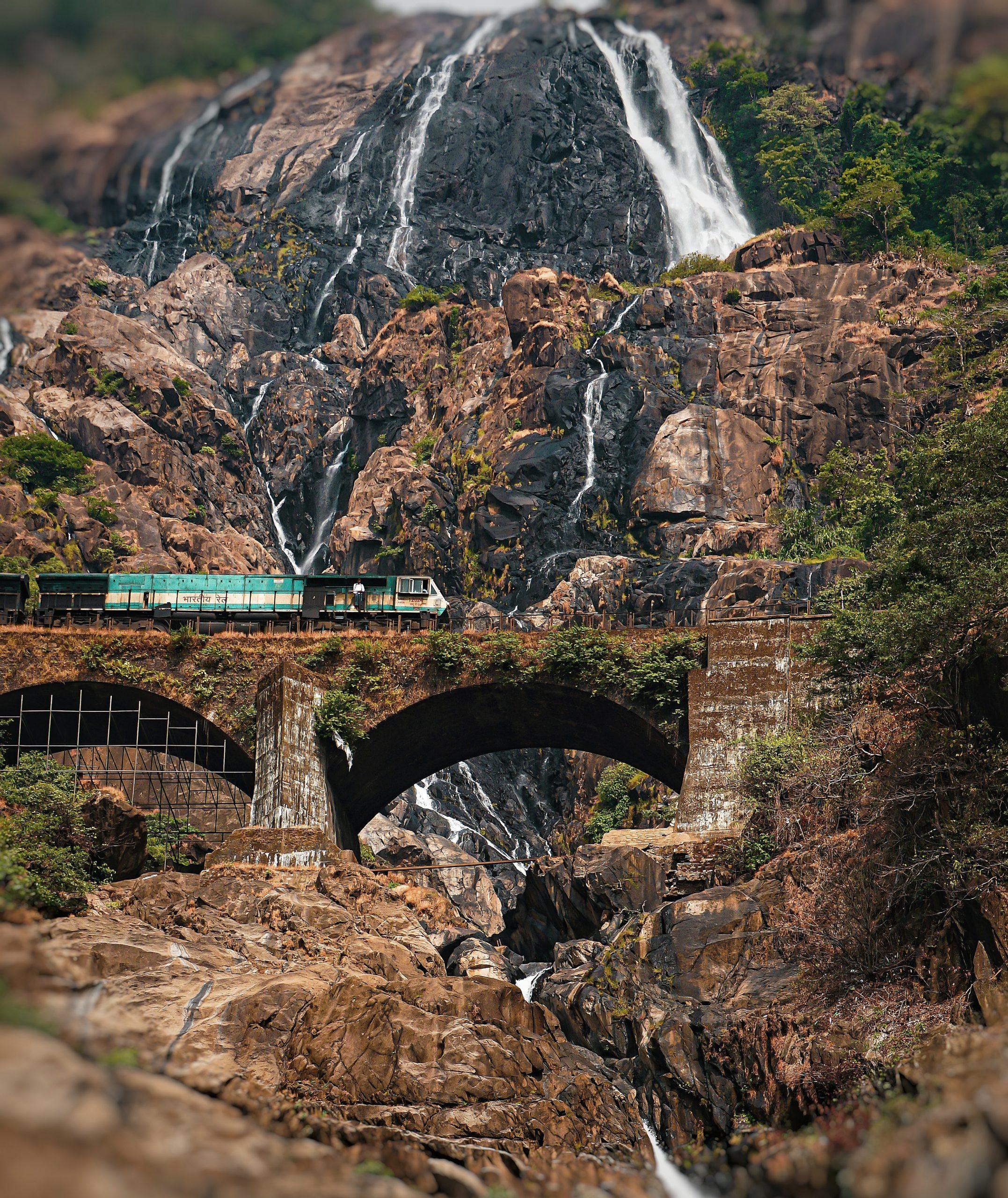 railway track going through waterfalls