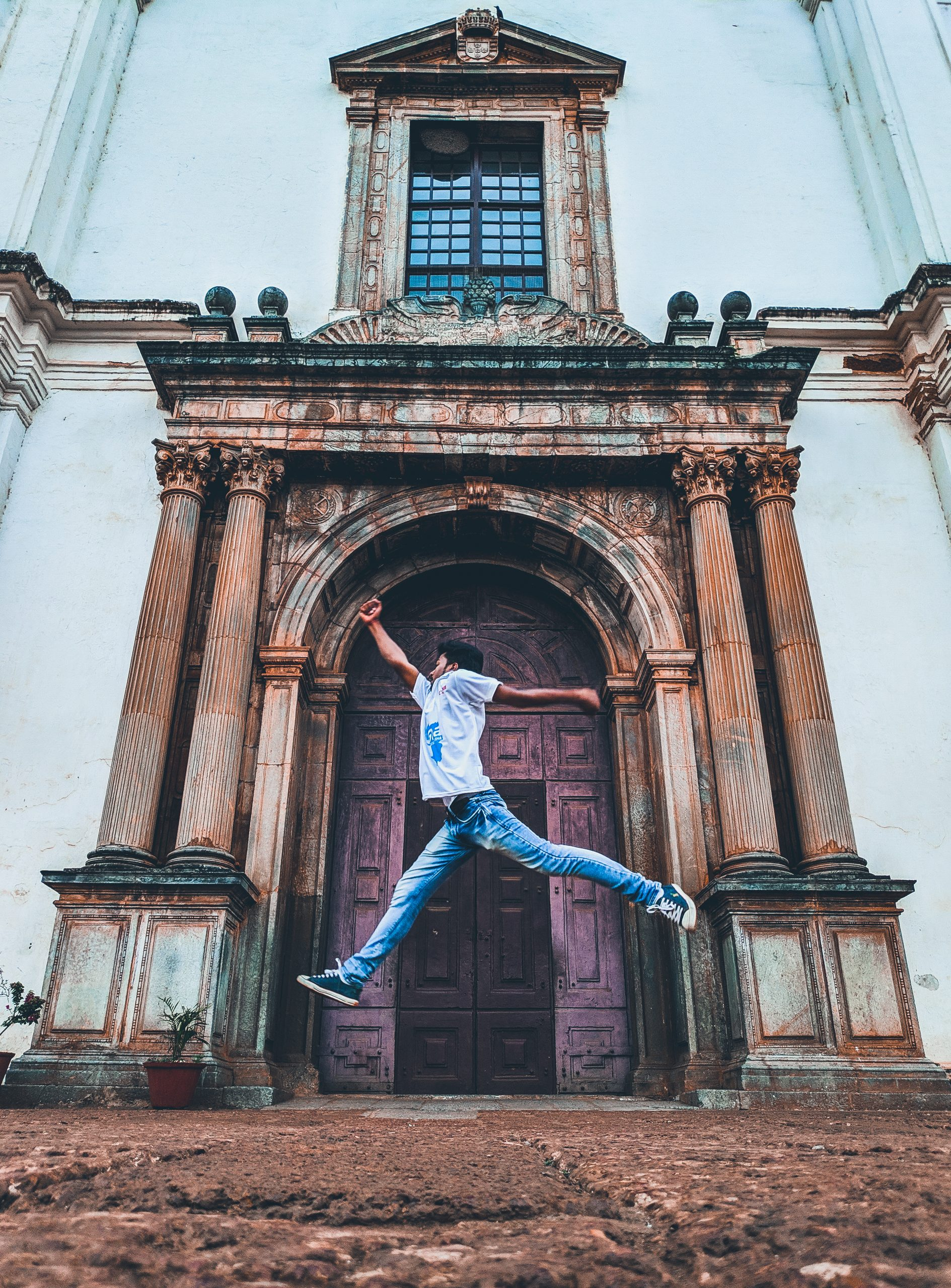 Man Jump Shot in Front of Se Cathedral in India