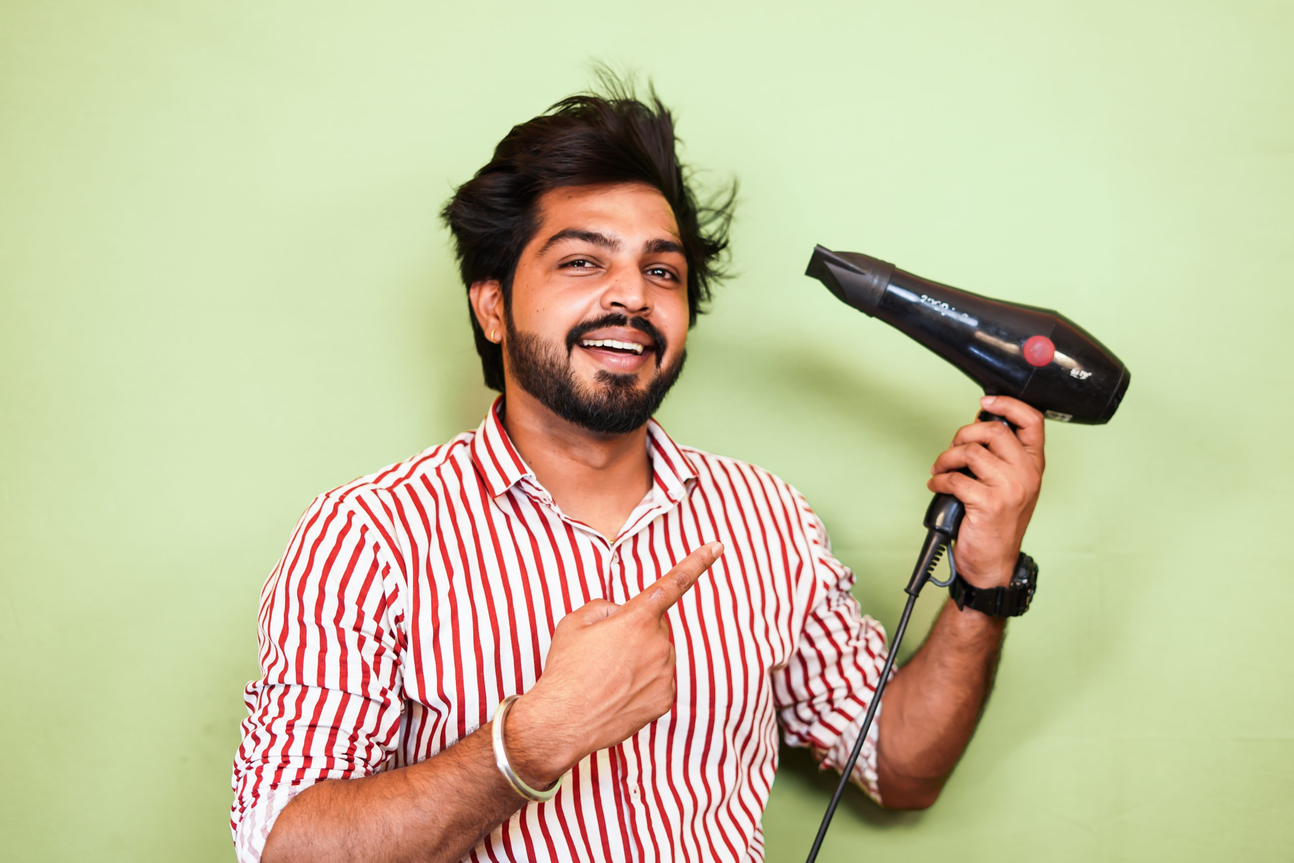 Man Pointing the Hair Dryer in his Hand