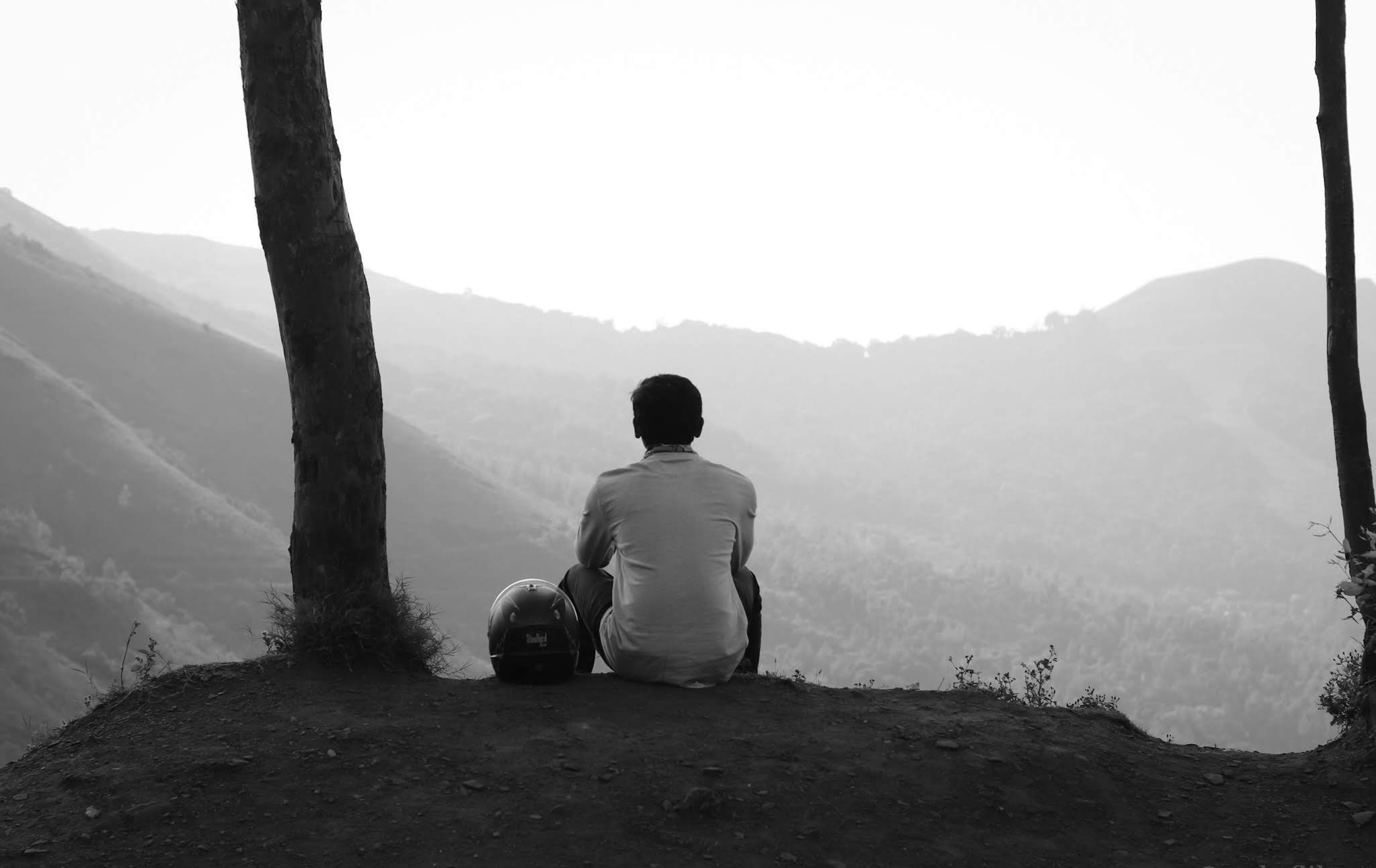 Man Sitting and Looking at the Mountains Scenery