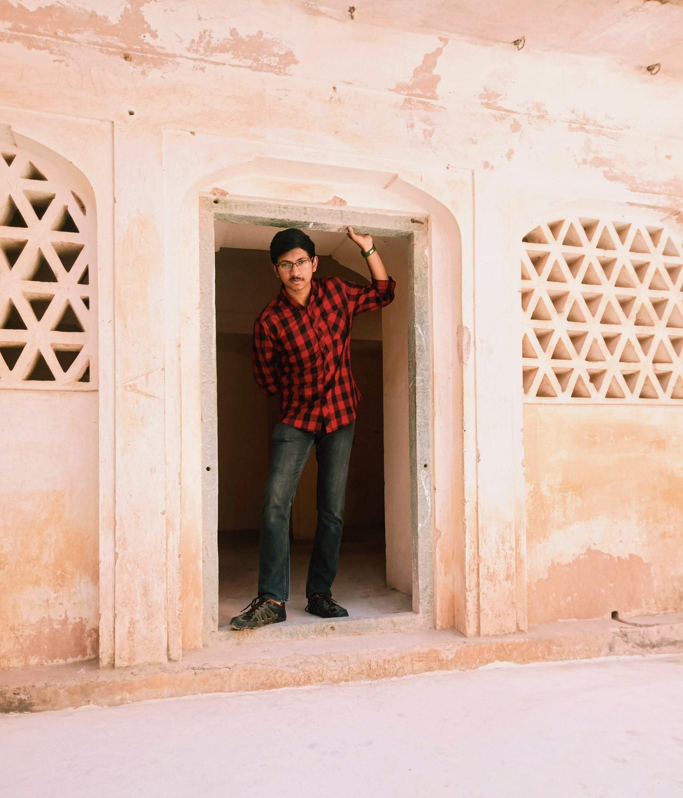 Man Standing in Doorway