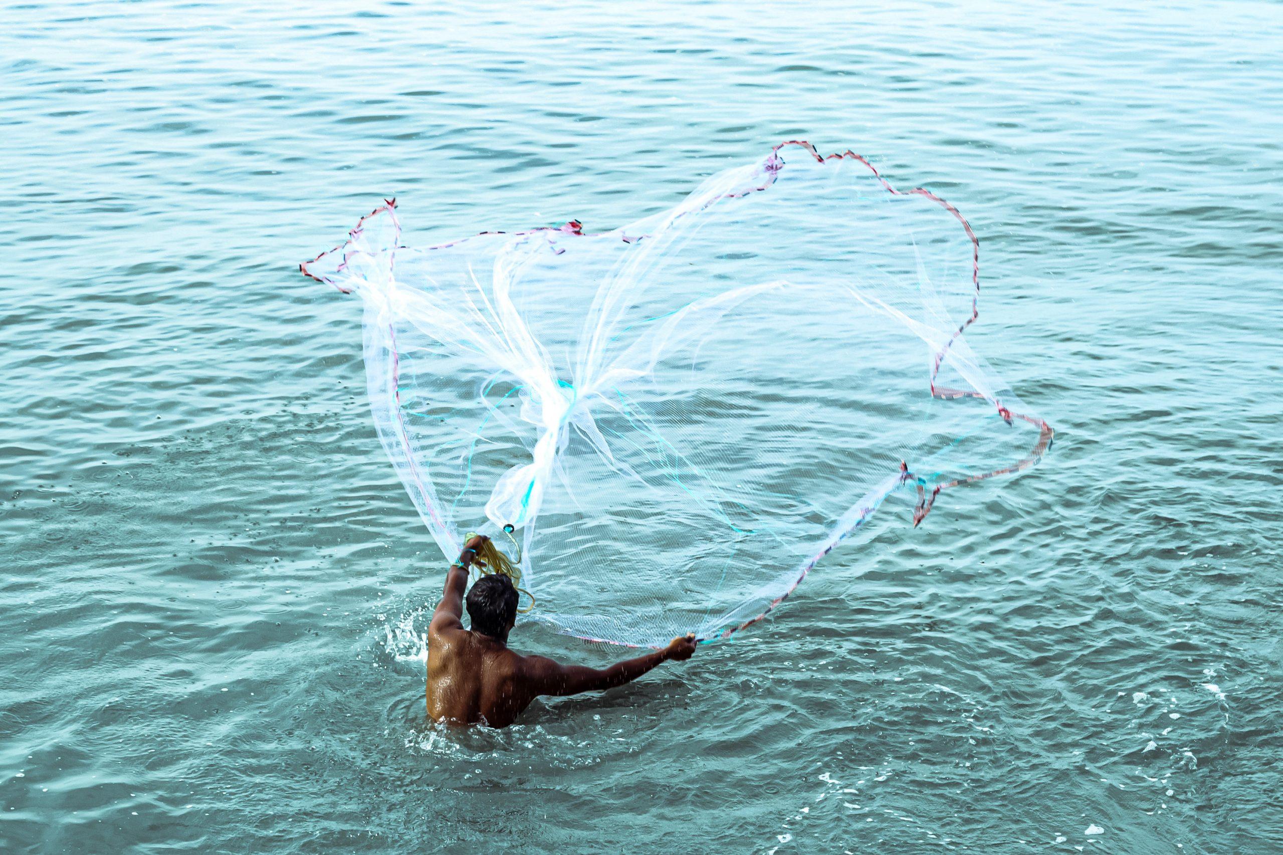 Man Throwing a Fishing Net