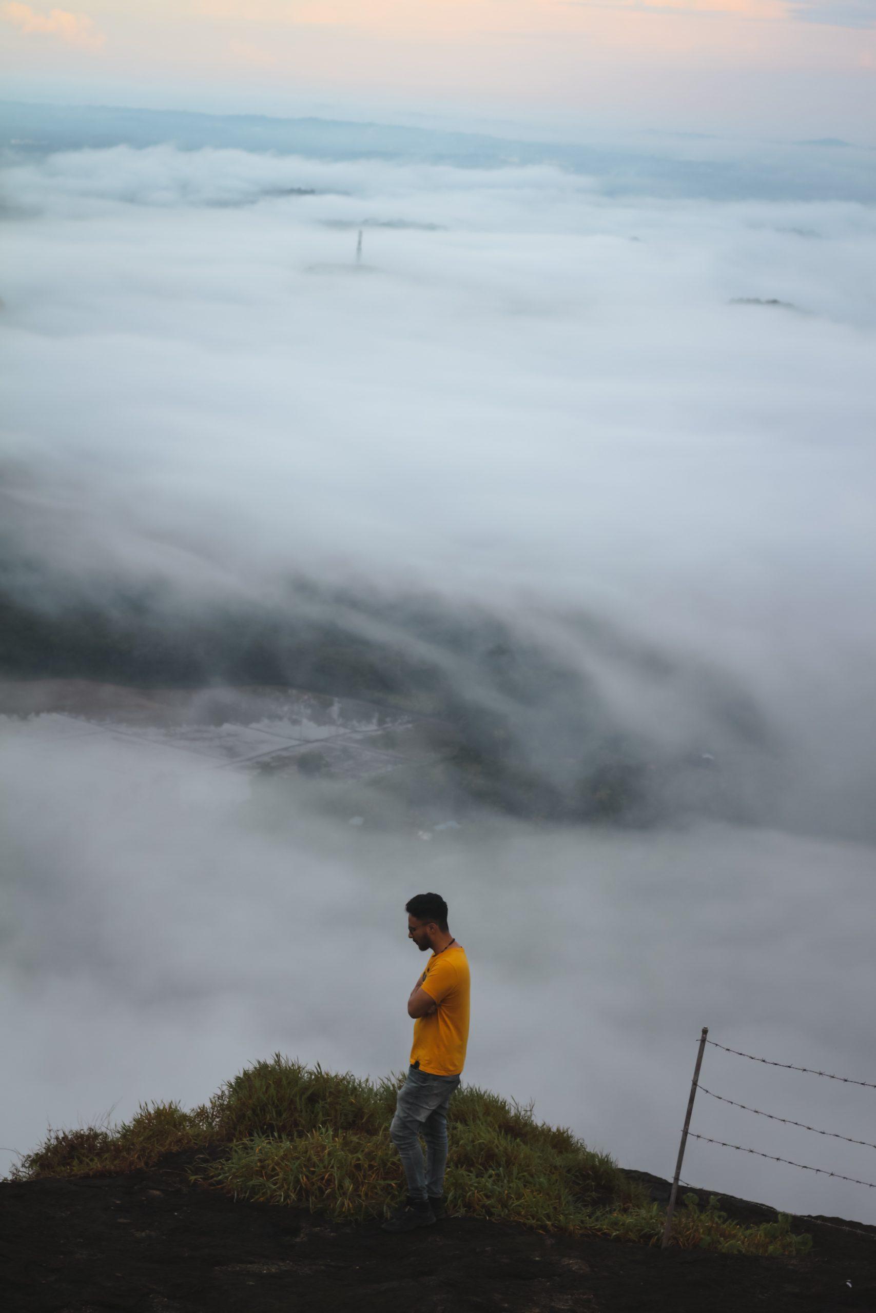 Man at a mountain peak