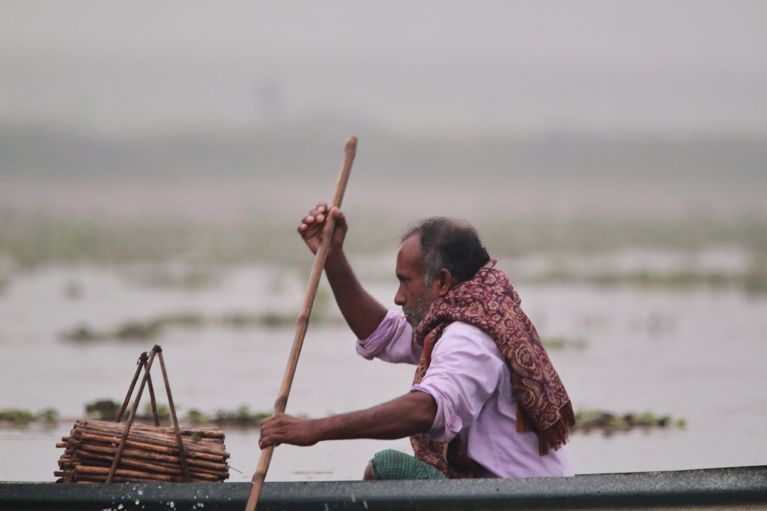 Old man riding a boat.