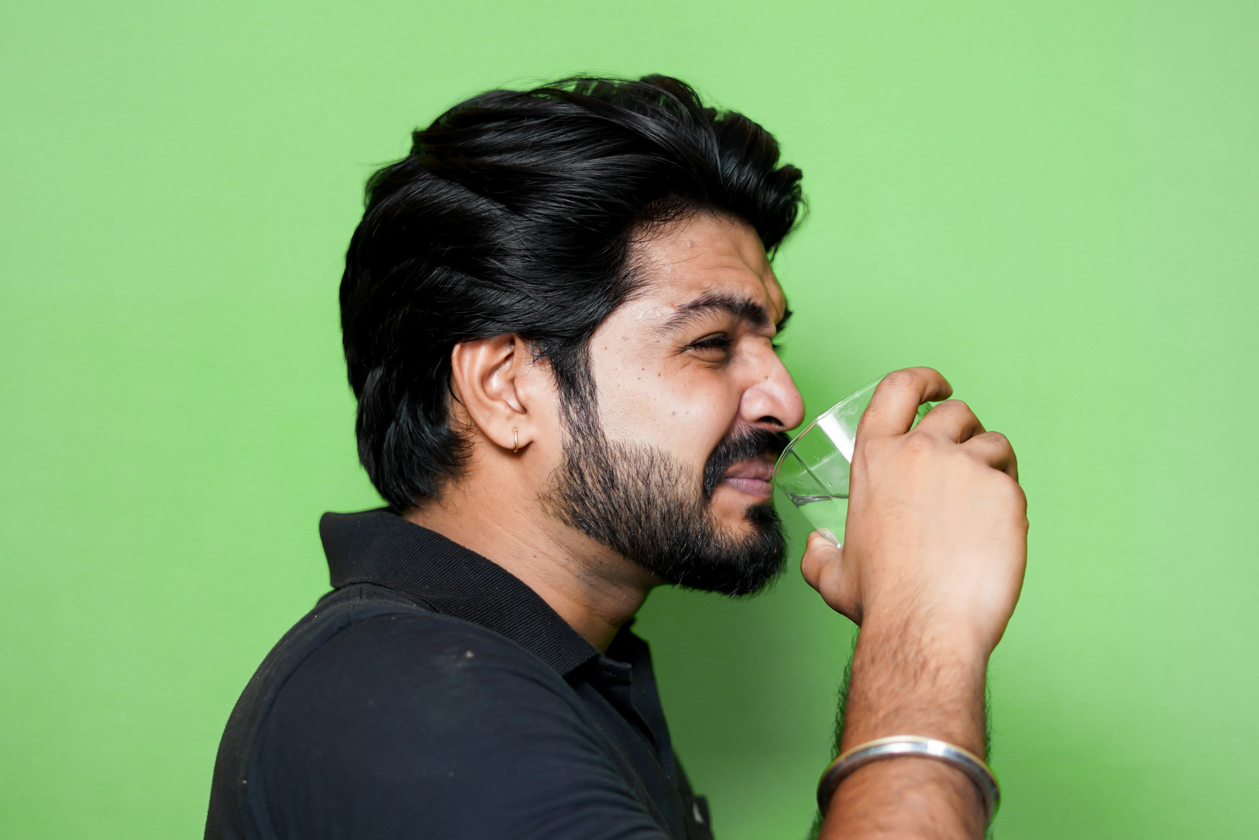 Man drinking something with expression