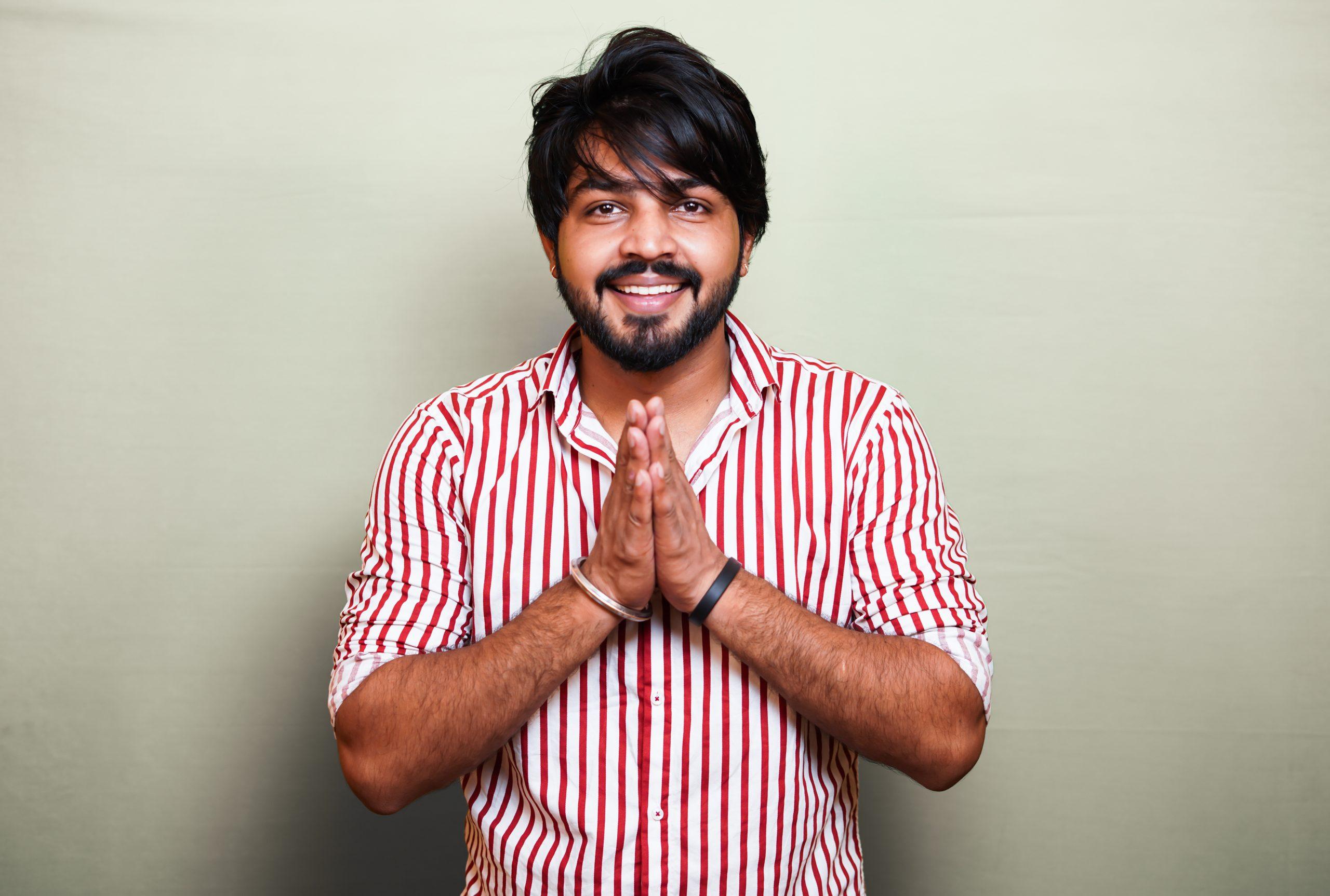 Man folding hands in Namaste