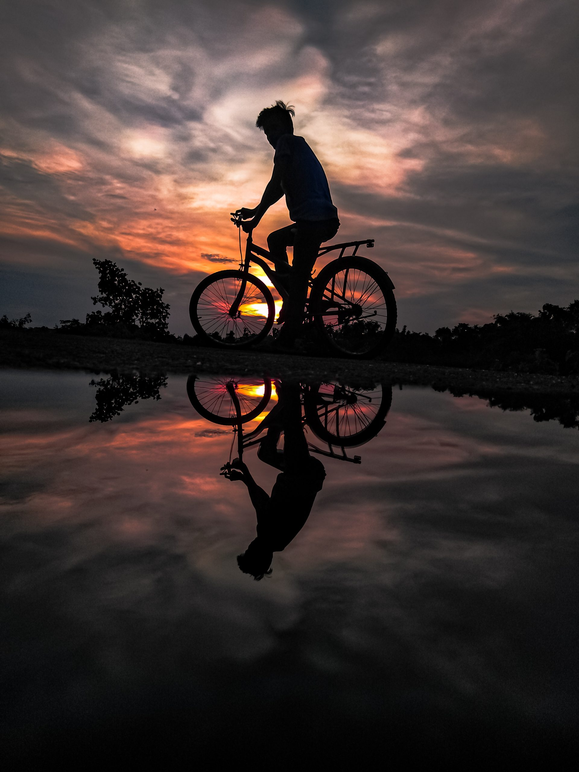 Man in a Bicycle Watching Sunset Scenery