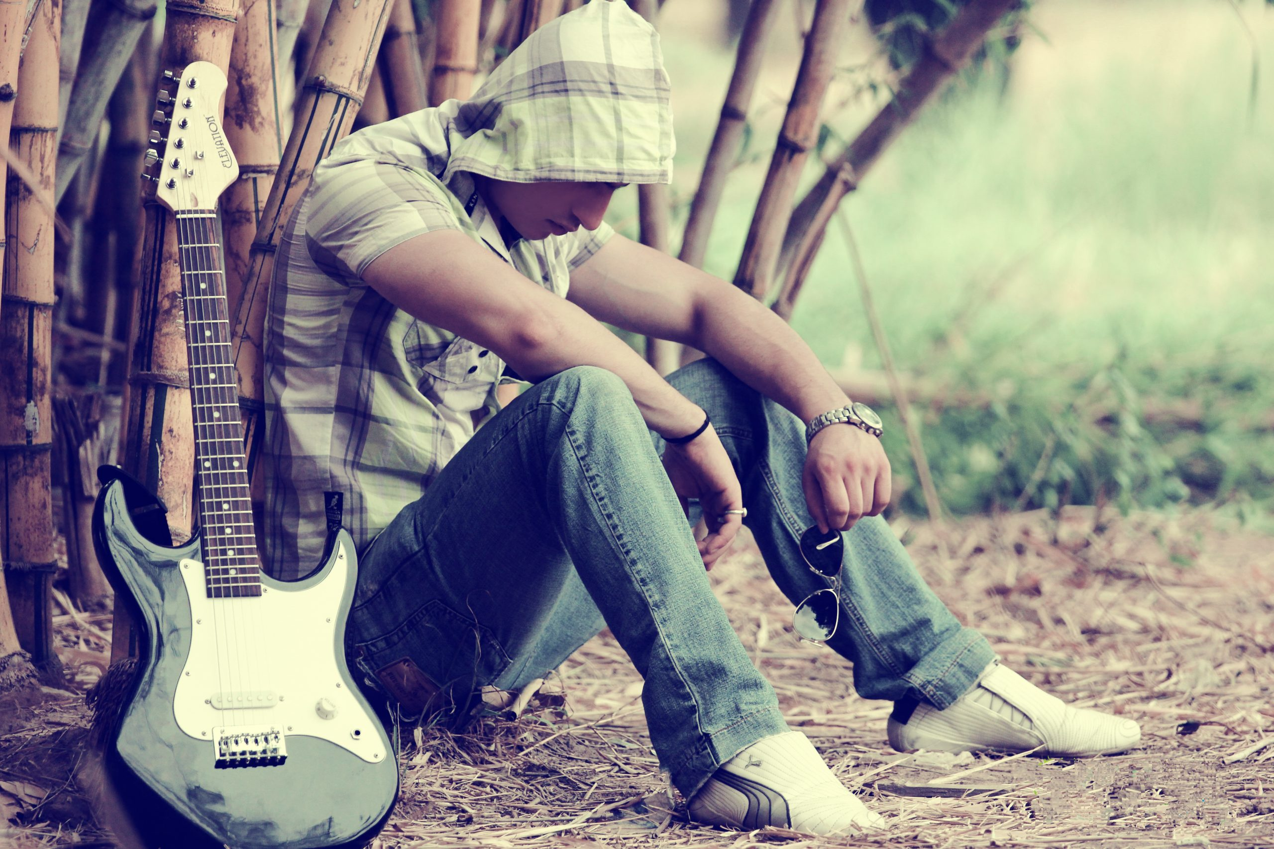 Man sitting with guitar