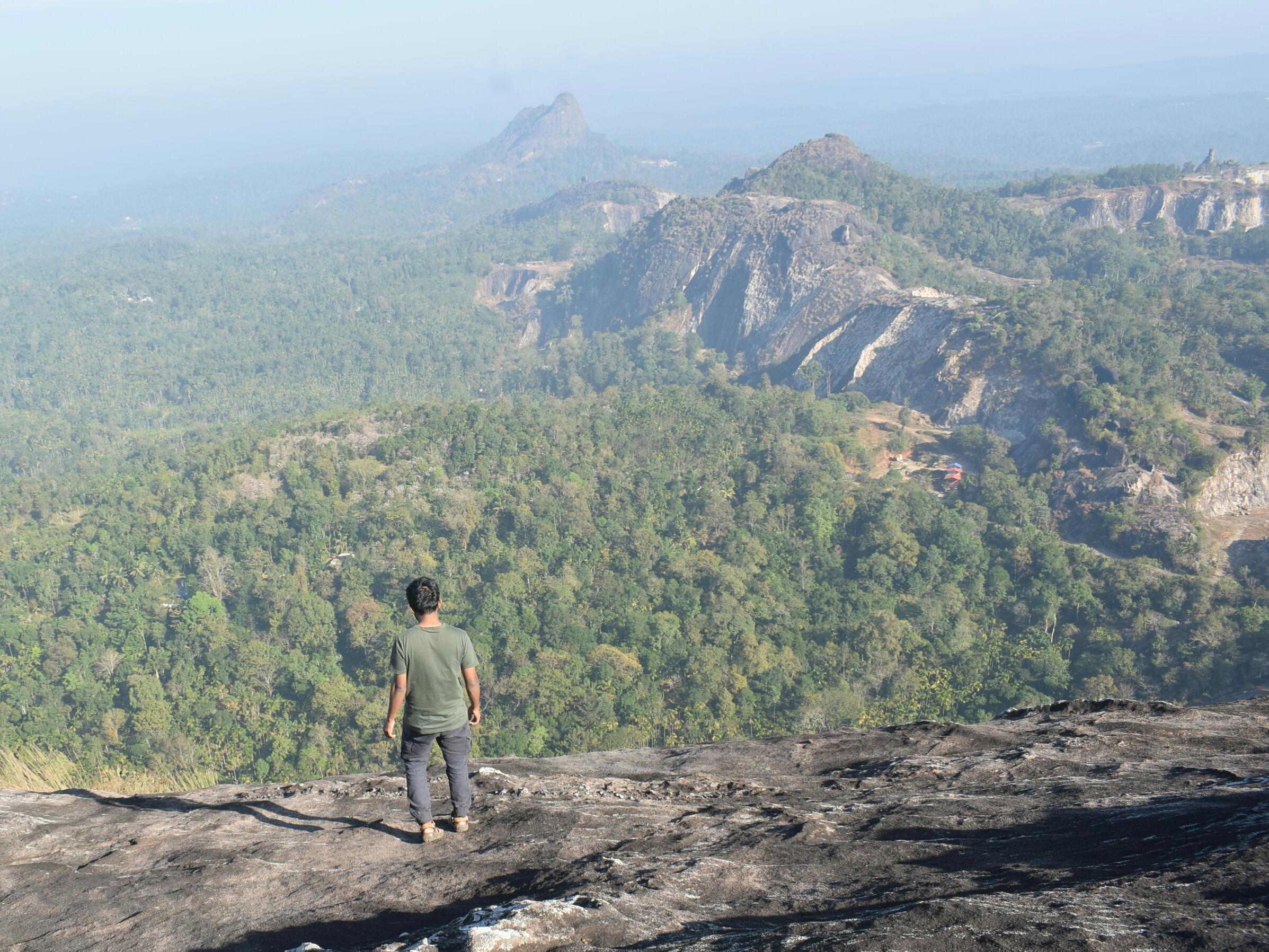 Man standing at hilltop