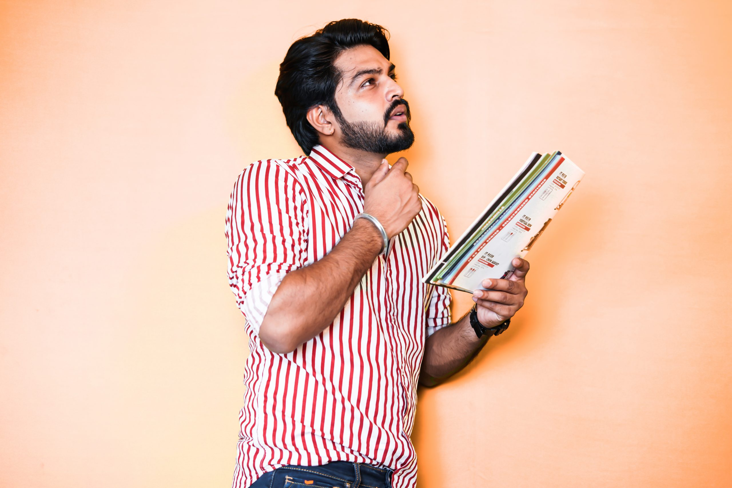 Man thinking while holding a Book