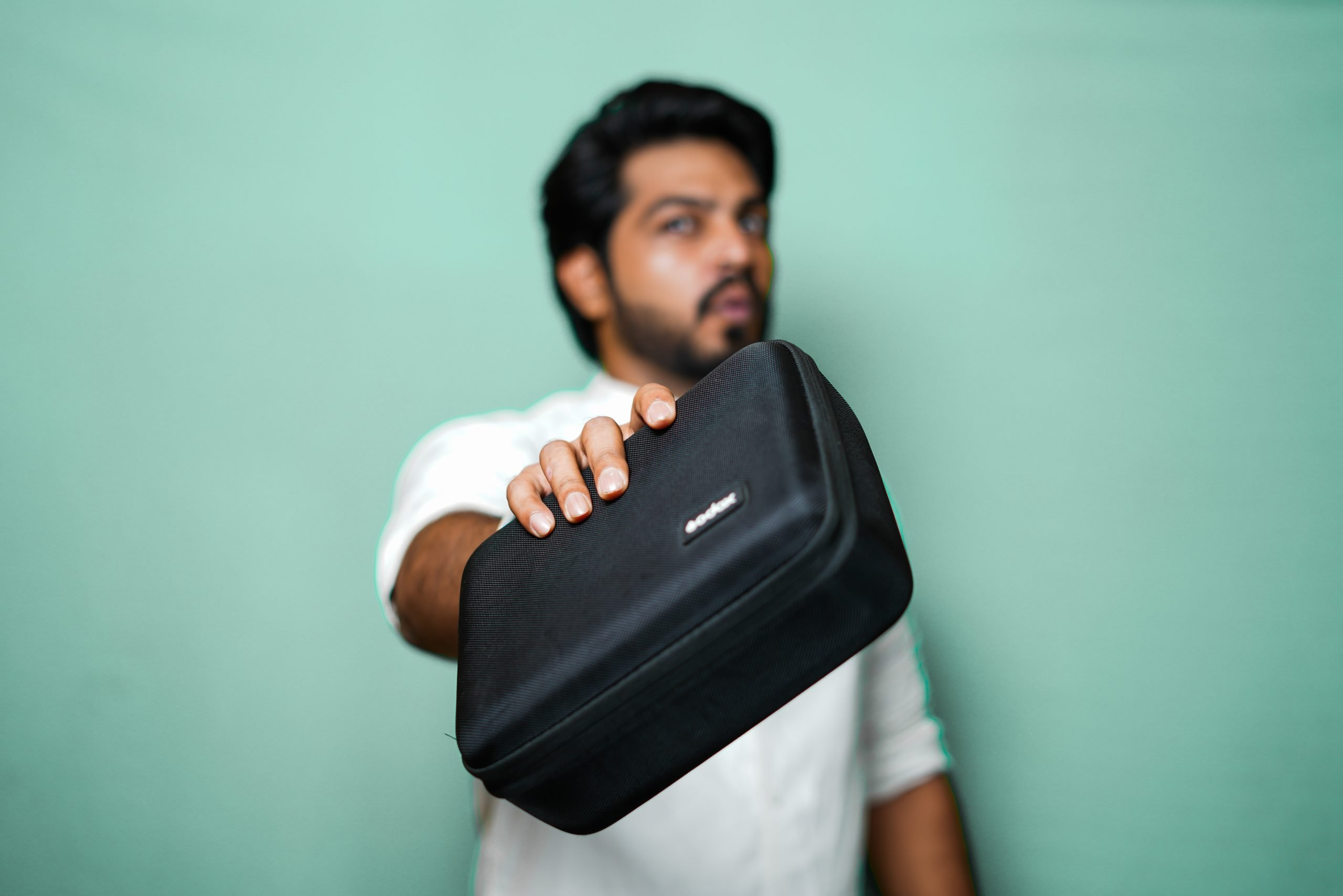 Man with His Pouch Bag in colour background