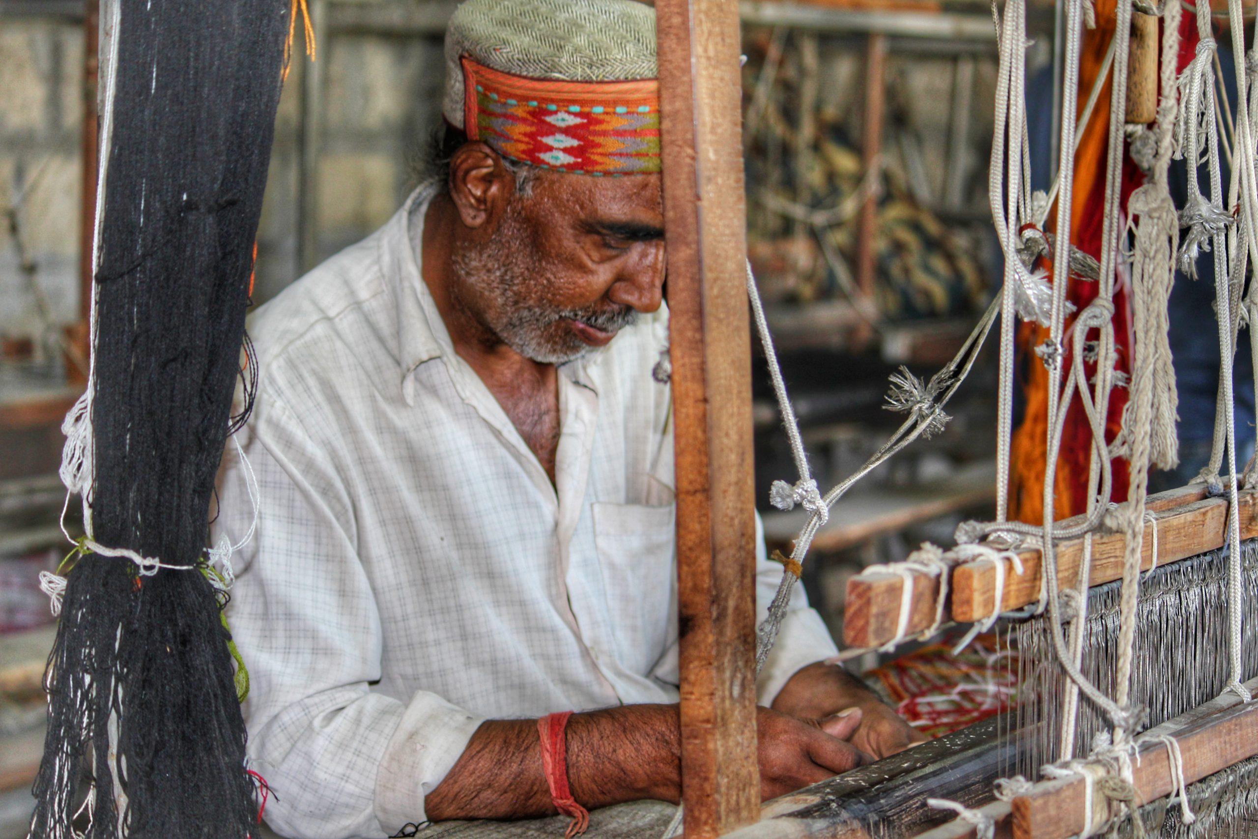 Man working in a fabric workshop of Shimla