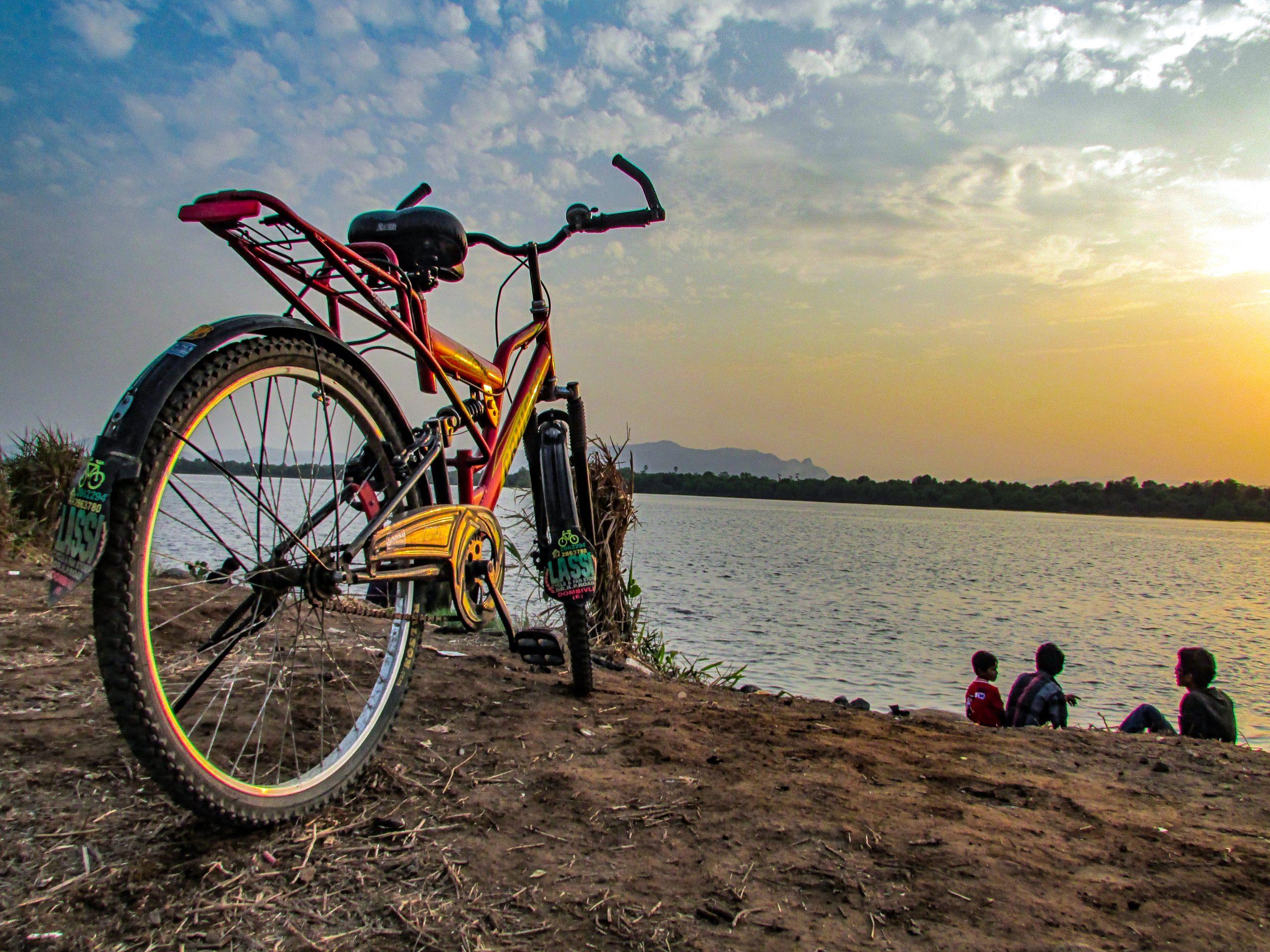 Friends enjoying sunset beside the river.