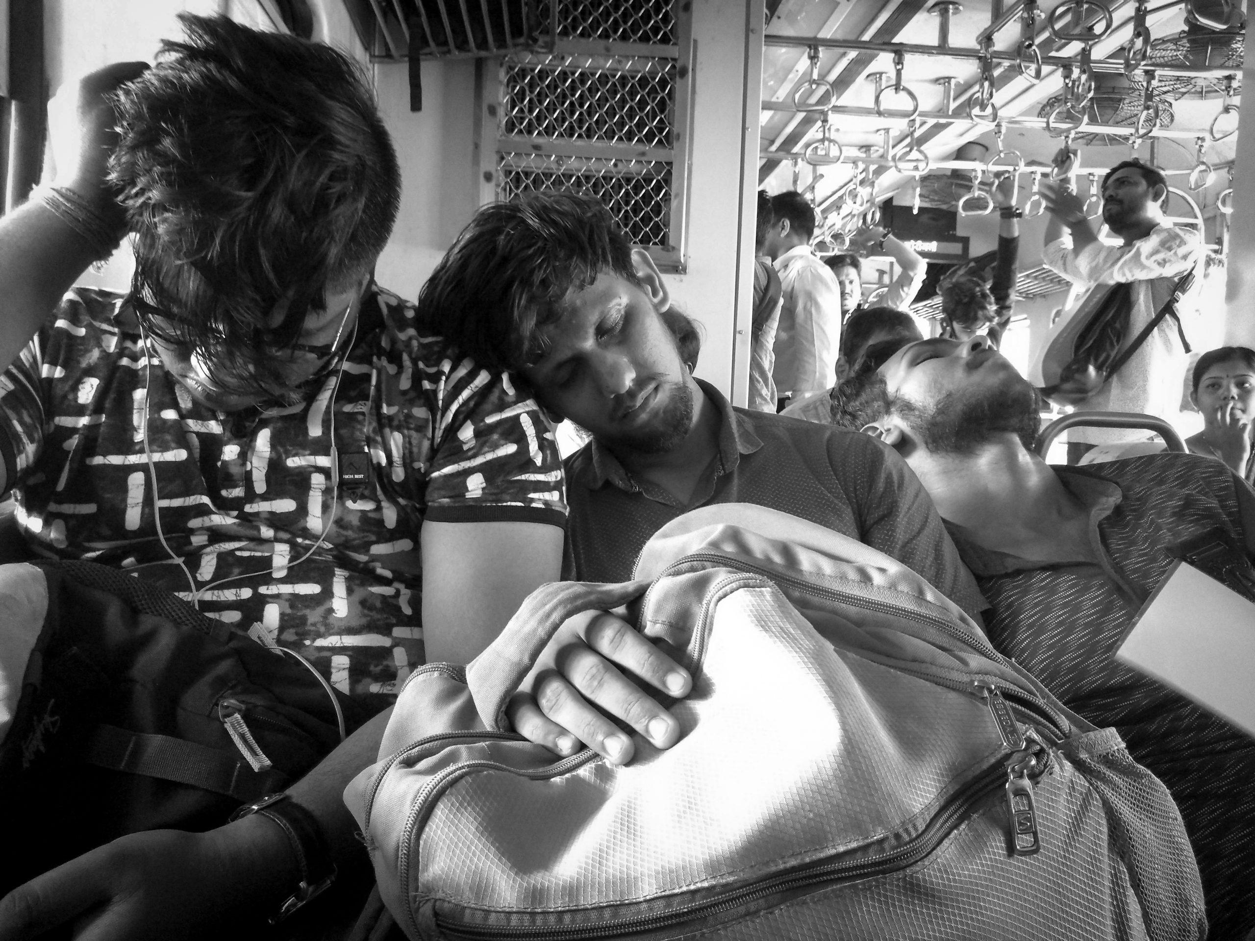 Men Sleeping on the Train