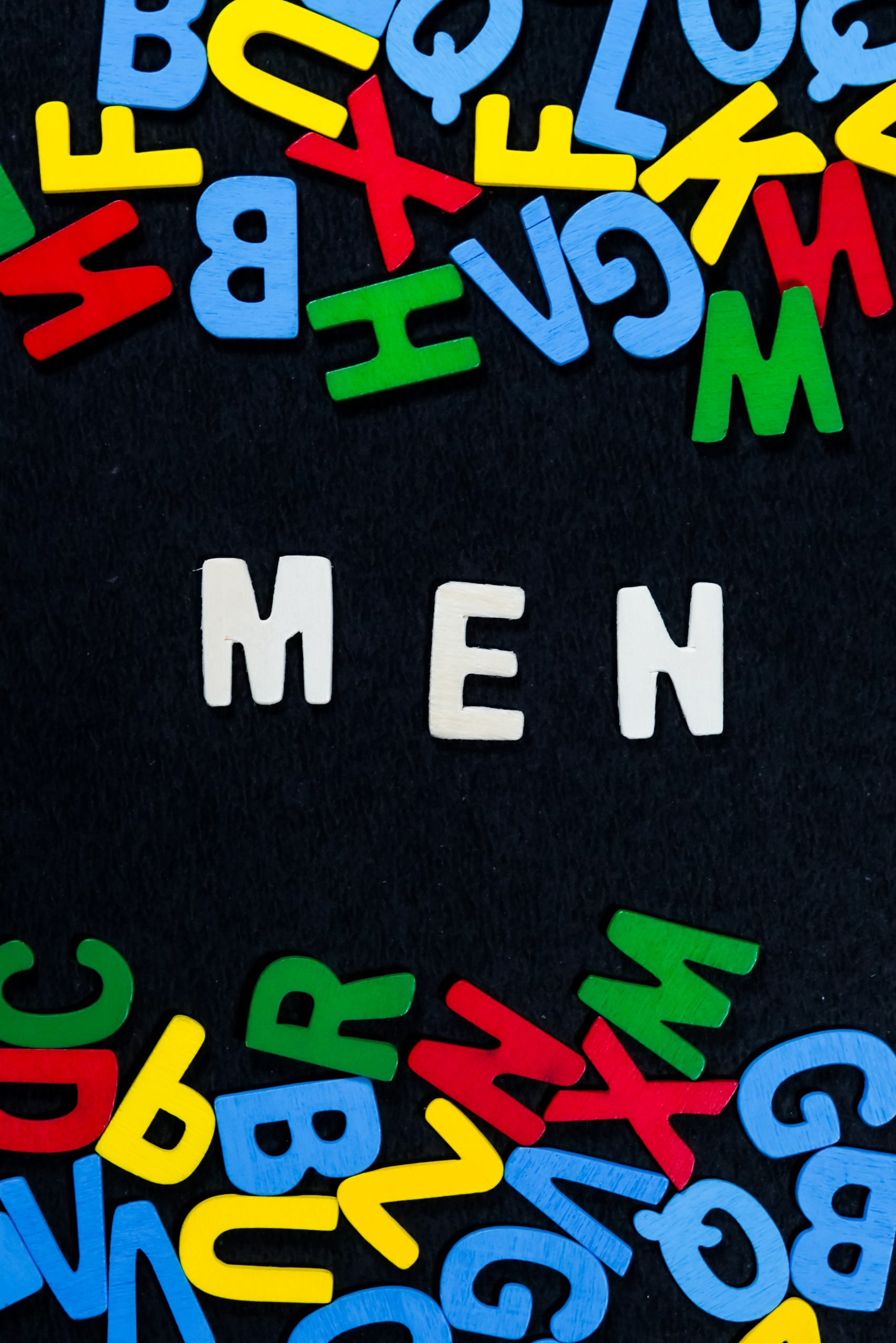 Men written on a scrabble