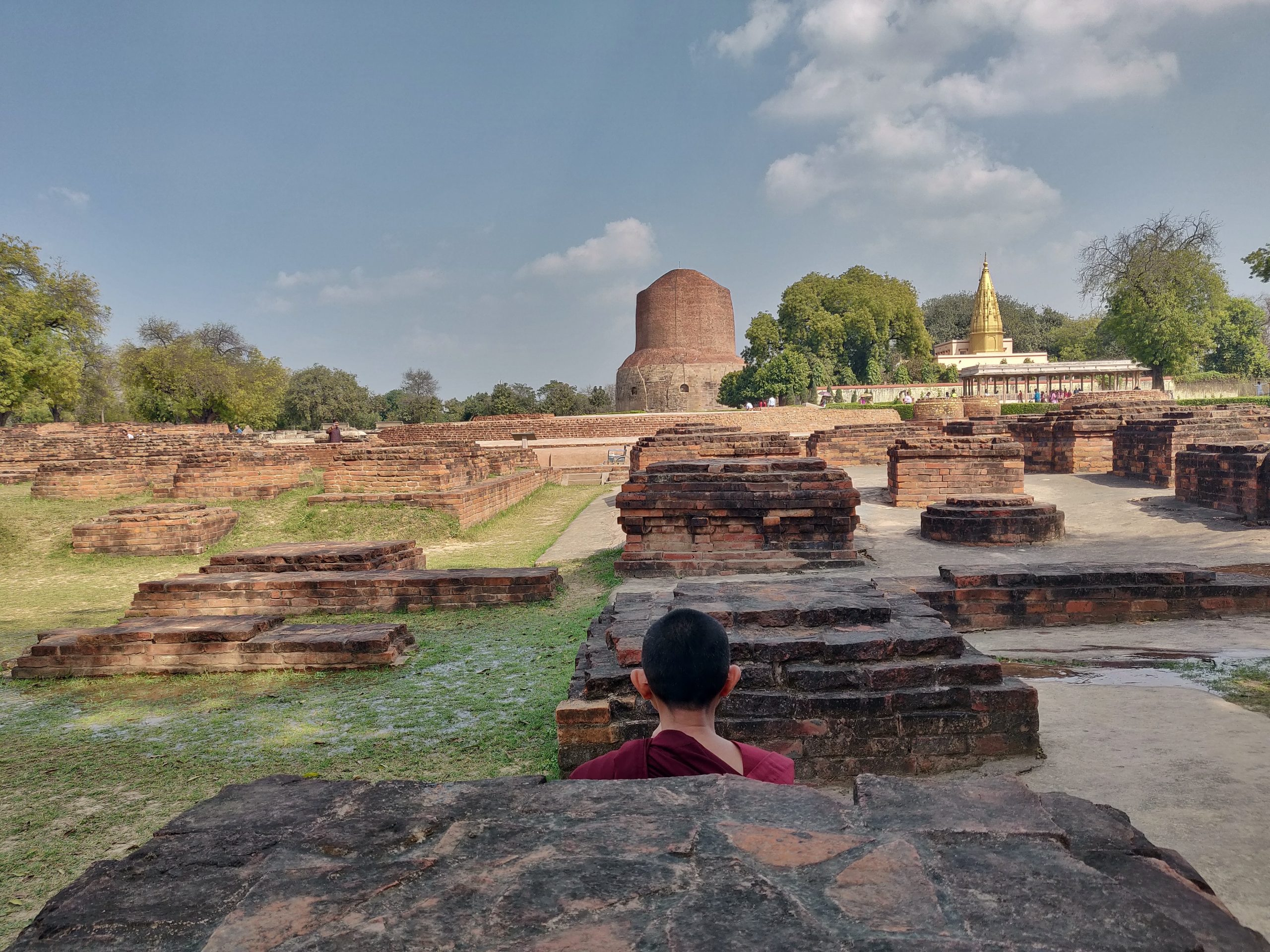Monk praying in Front of Dhamek Stupa, Sarnath.