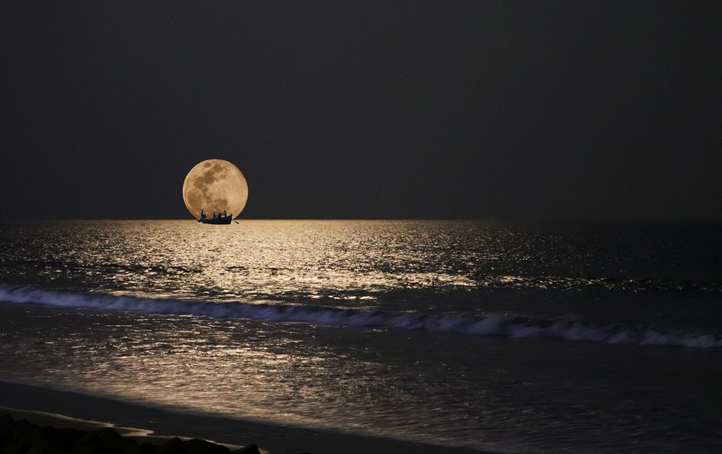 Moon touching the sea