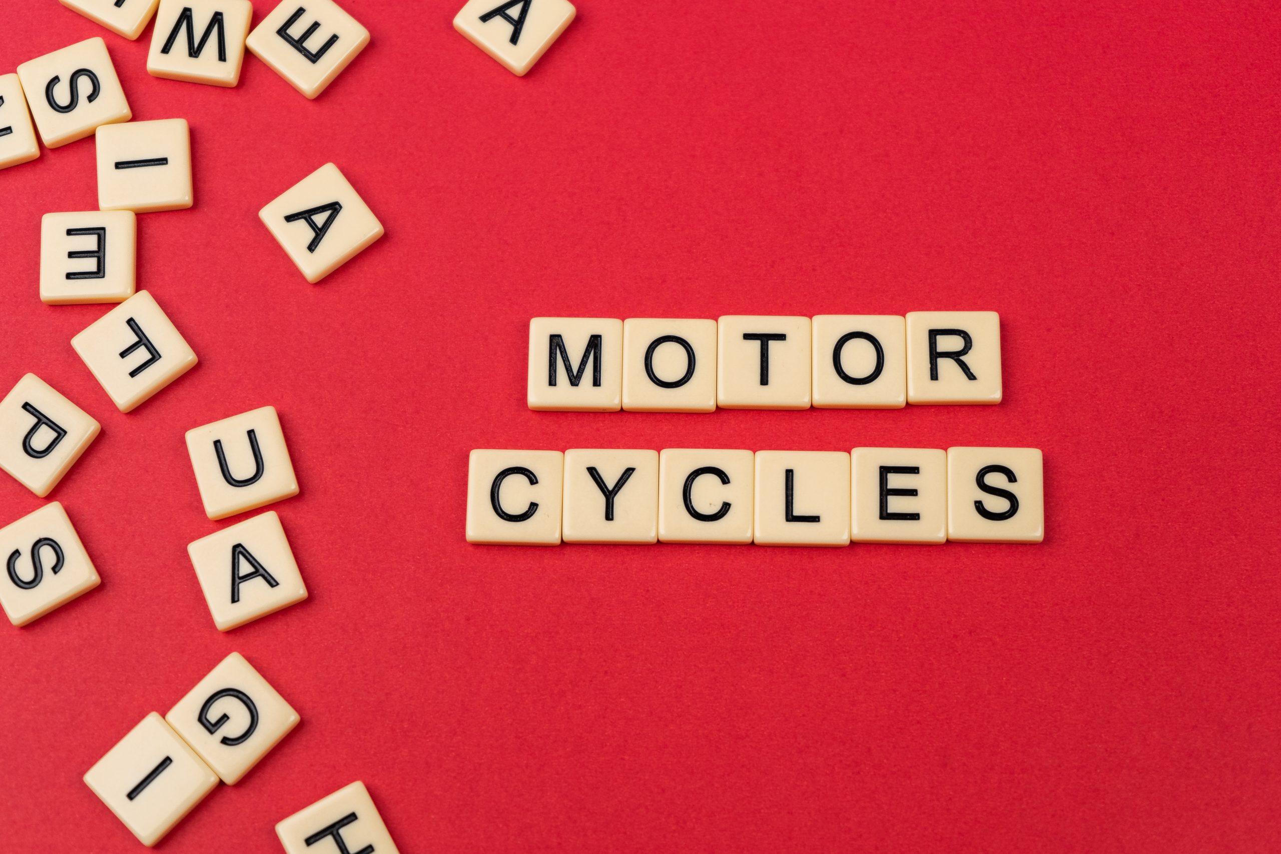 Motorcycles written on scrabble