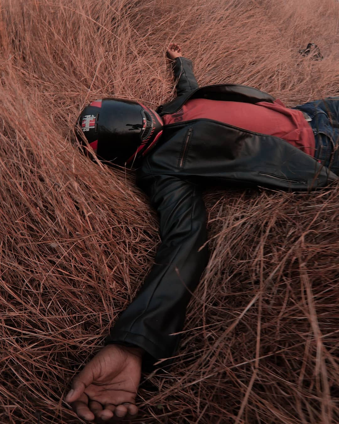 Motorcycle Rider Lying on Ground