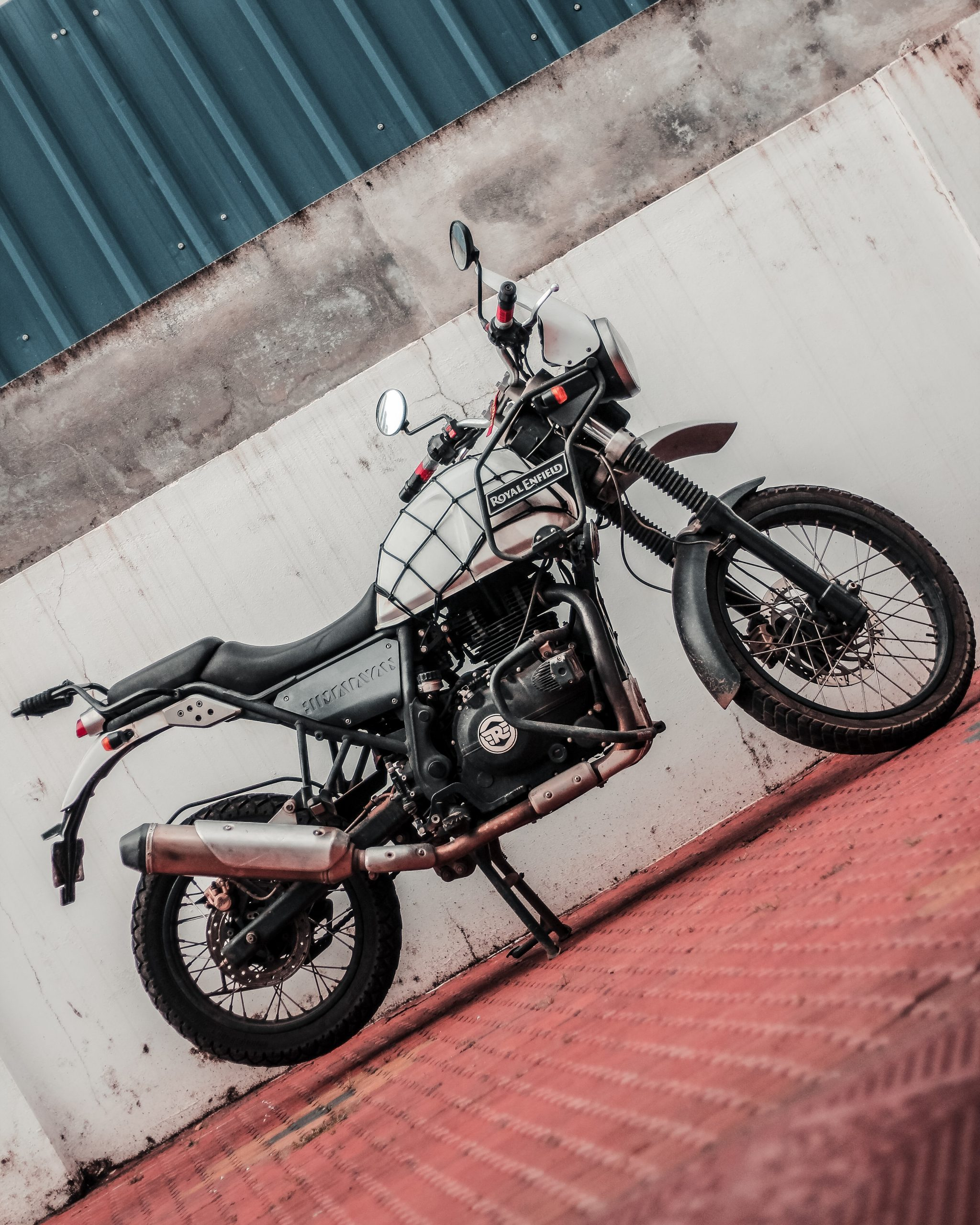 Motorcycle parked in front of the wall