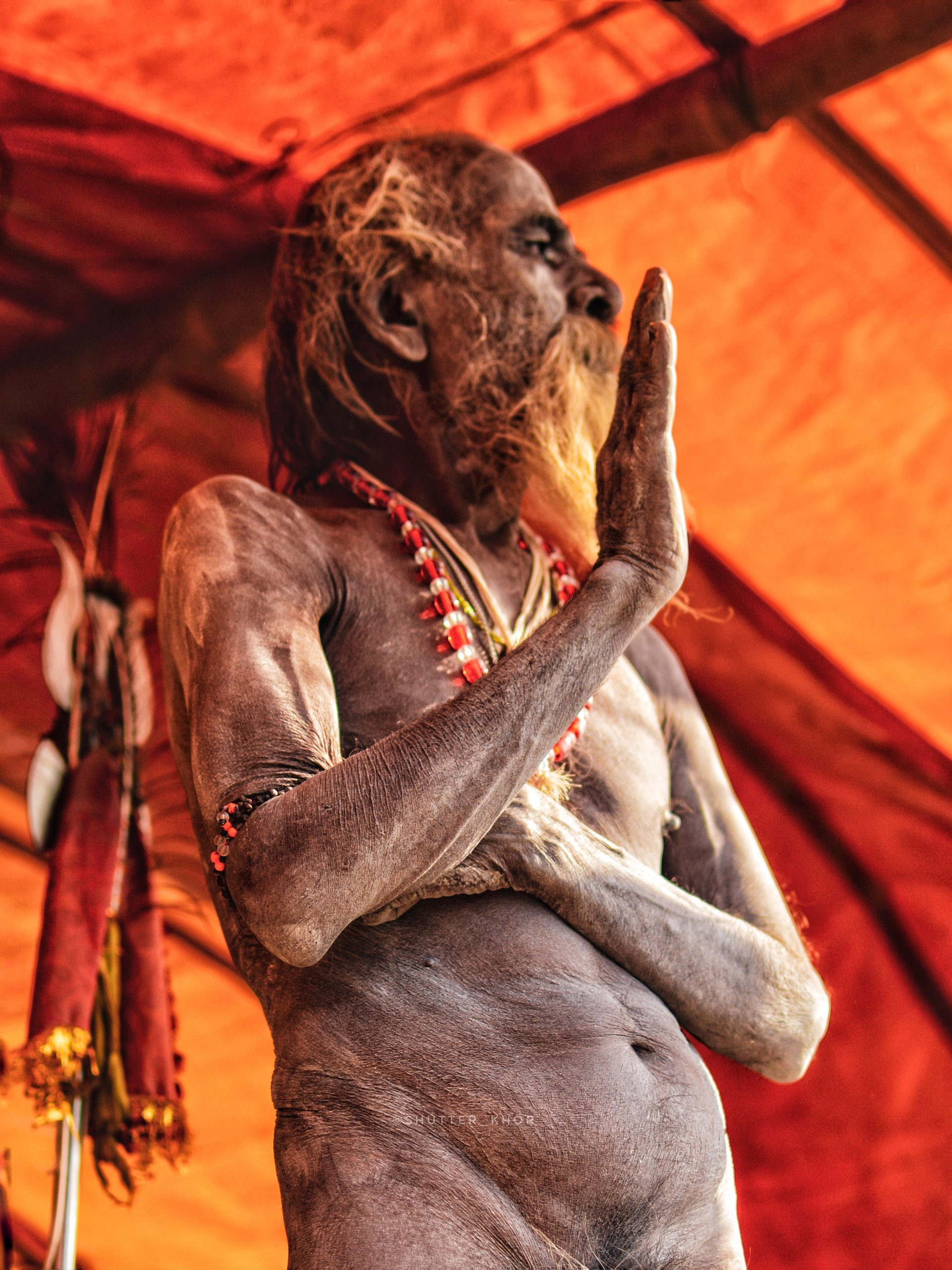 a naga sadhu offering his blessings