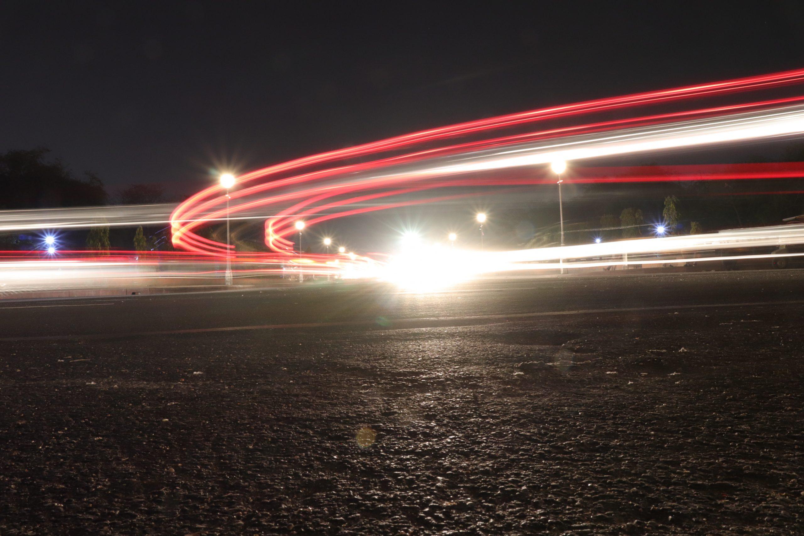 headlights of vehicles during night