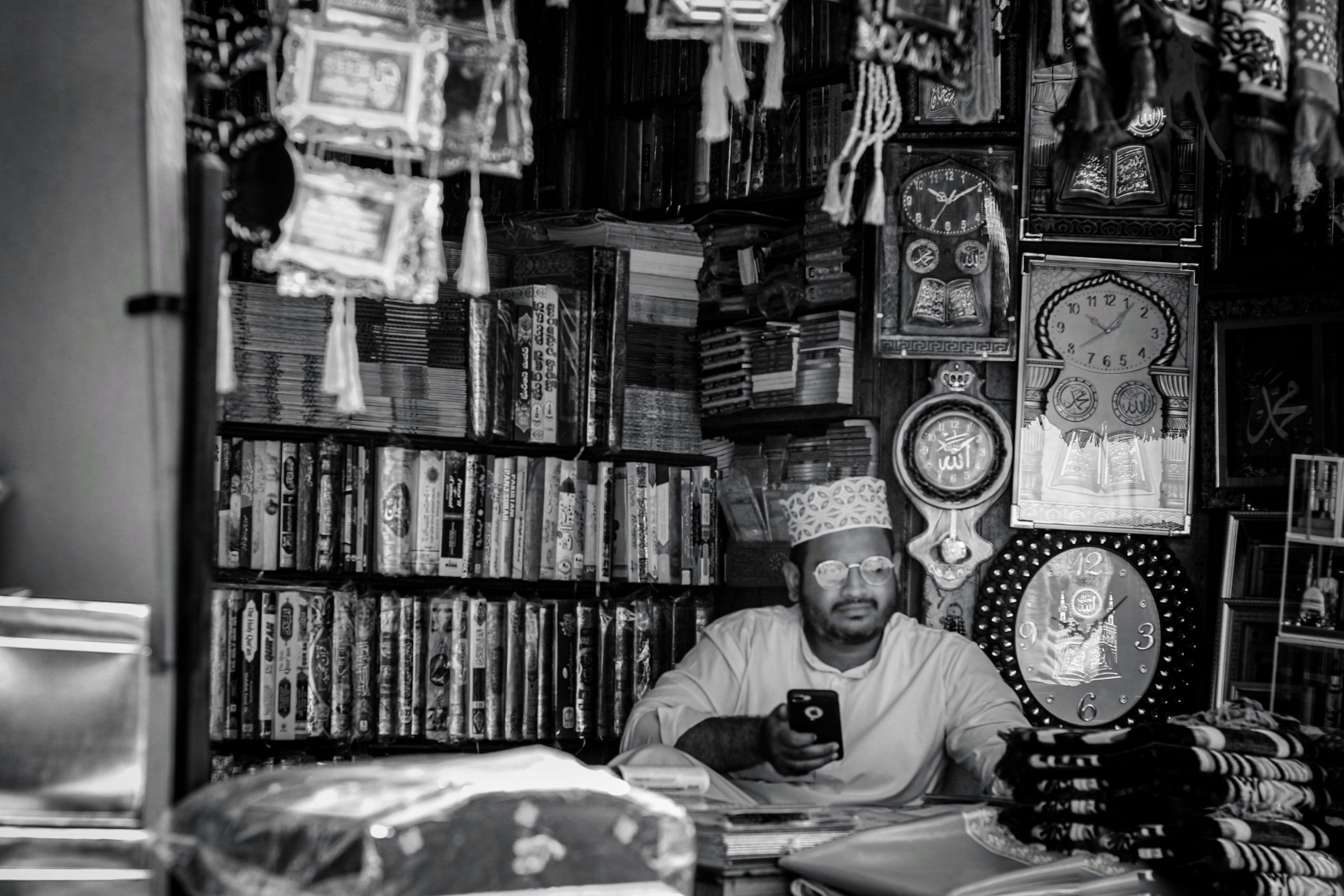 Shopkeeper watching over his merchandise