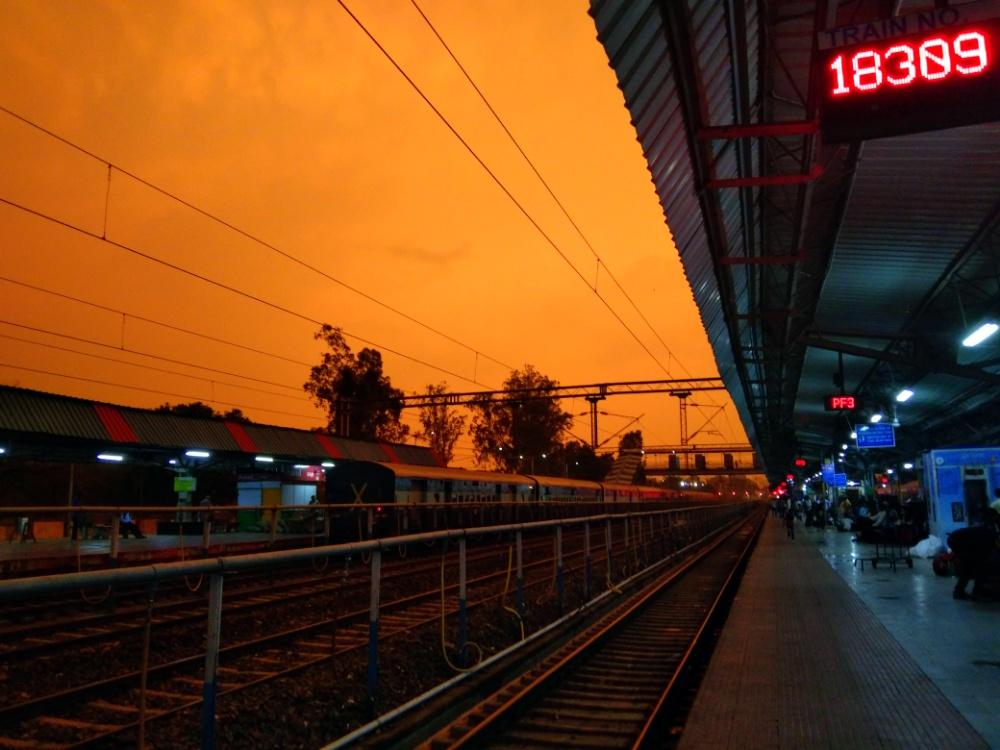 Orange sky on a train station