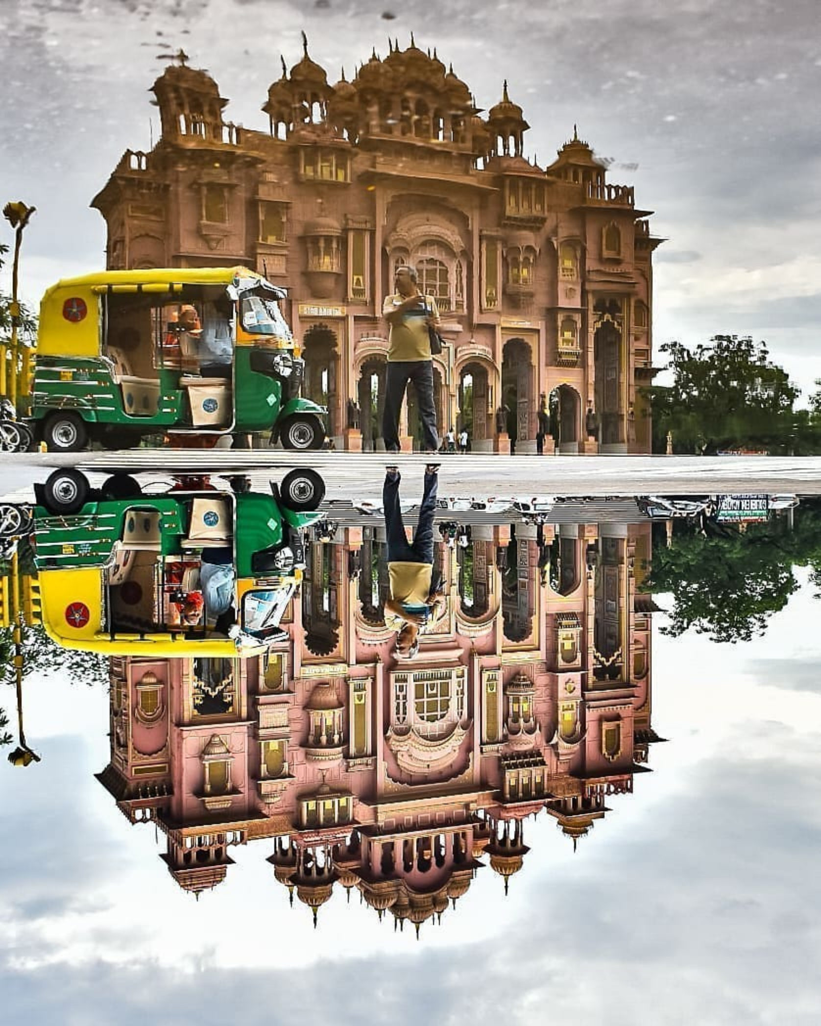 An autoriksha in front of a monument in Jaipur.