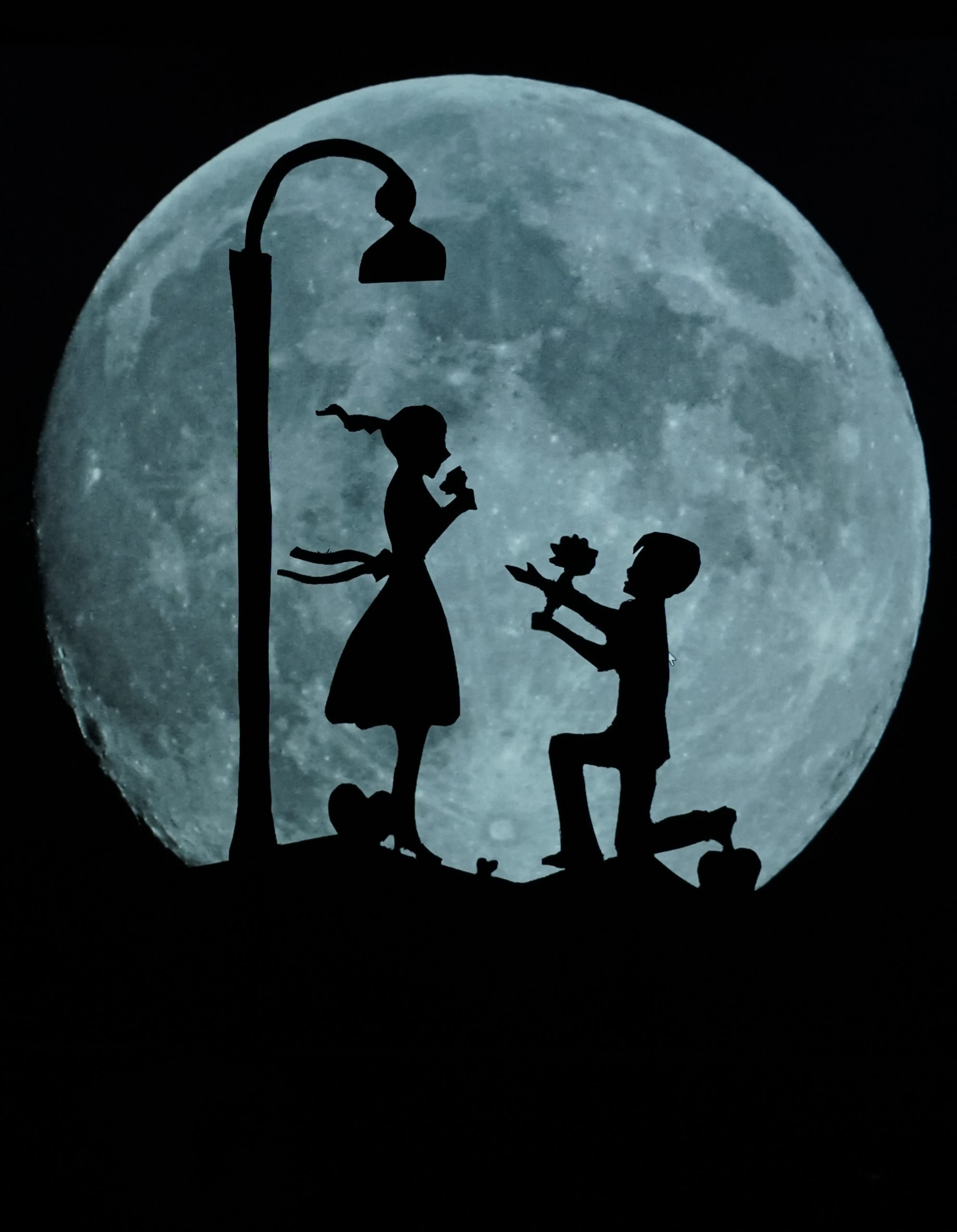 Paper art silhouette of a couple