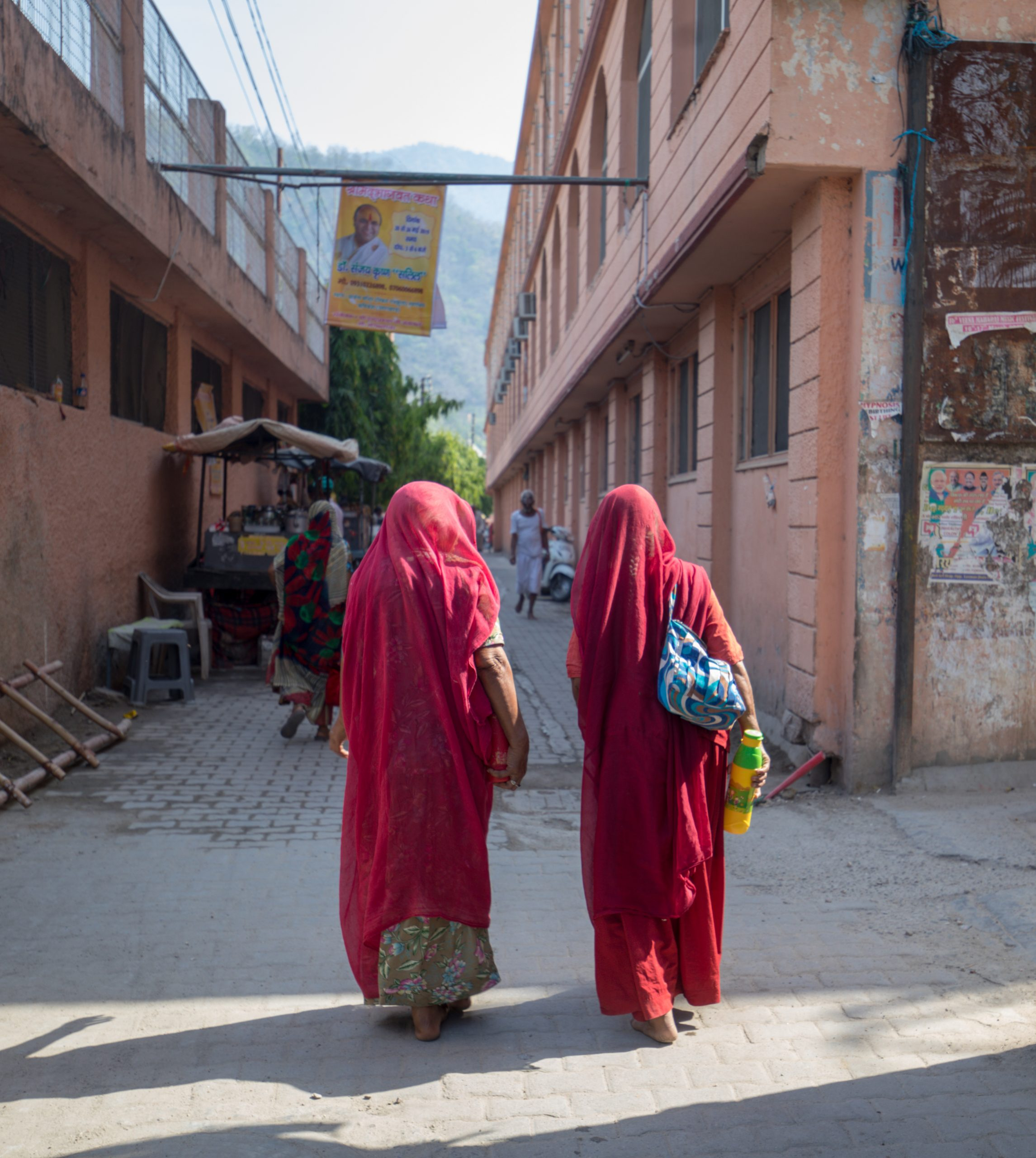 Two Indian Women Walking Towards the Alley
