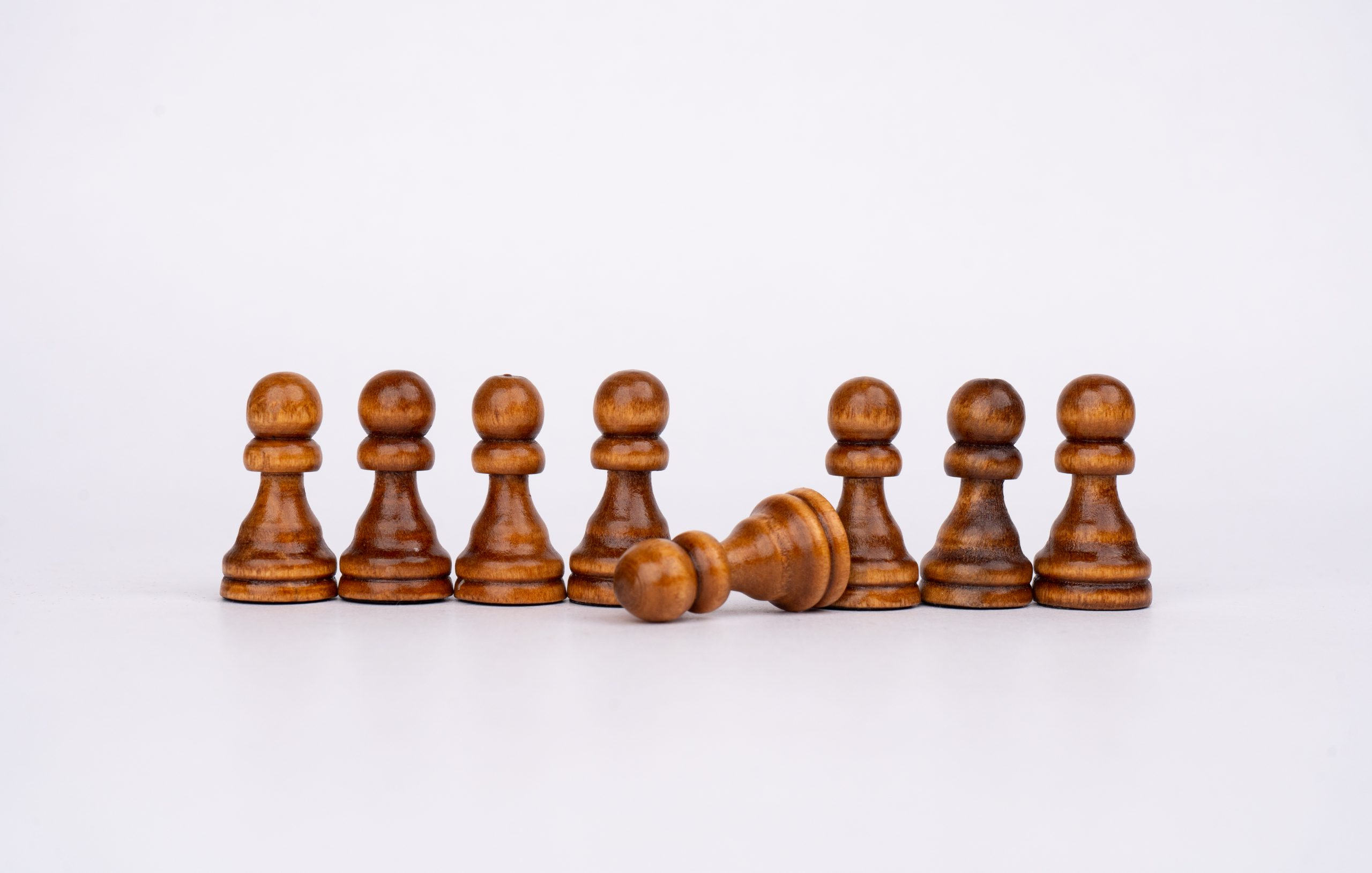 Pawns formation on white background