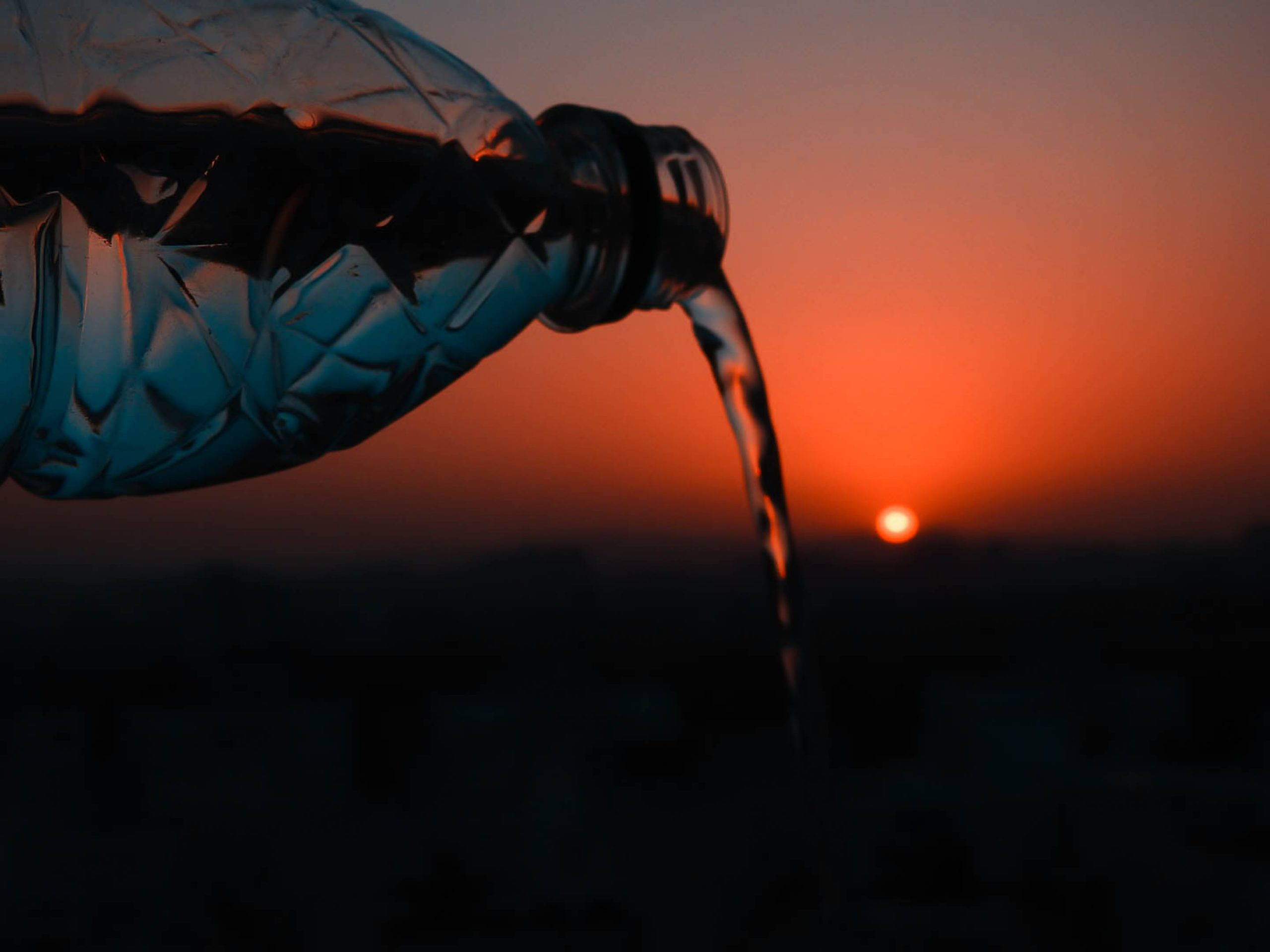 Pouring water during sunset
