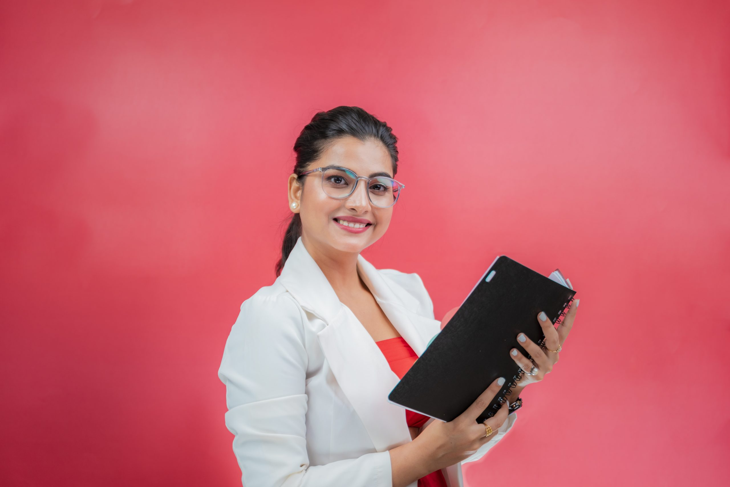 Professional woman holding notebook