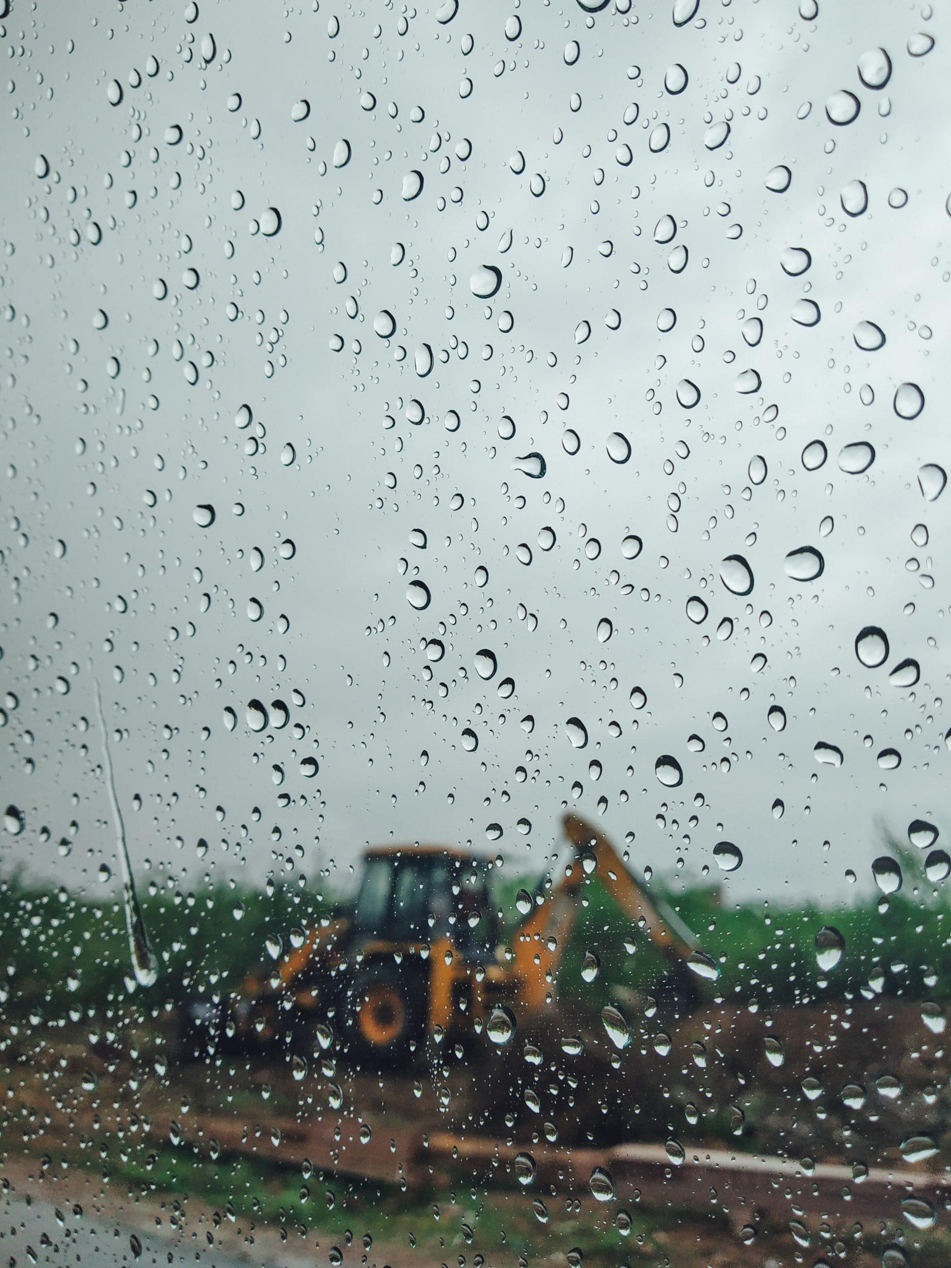 Rain drops on car window glass