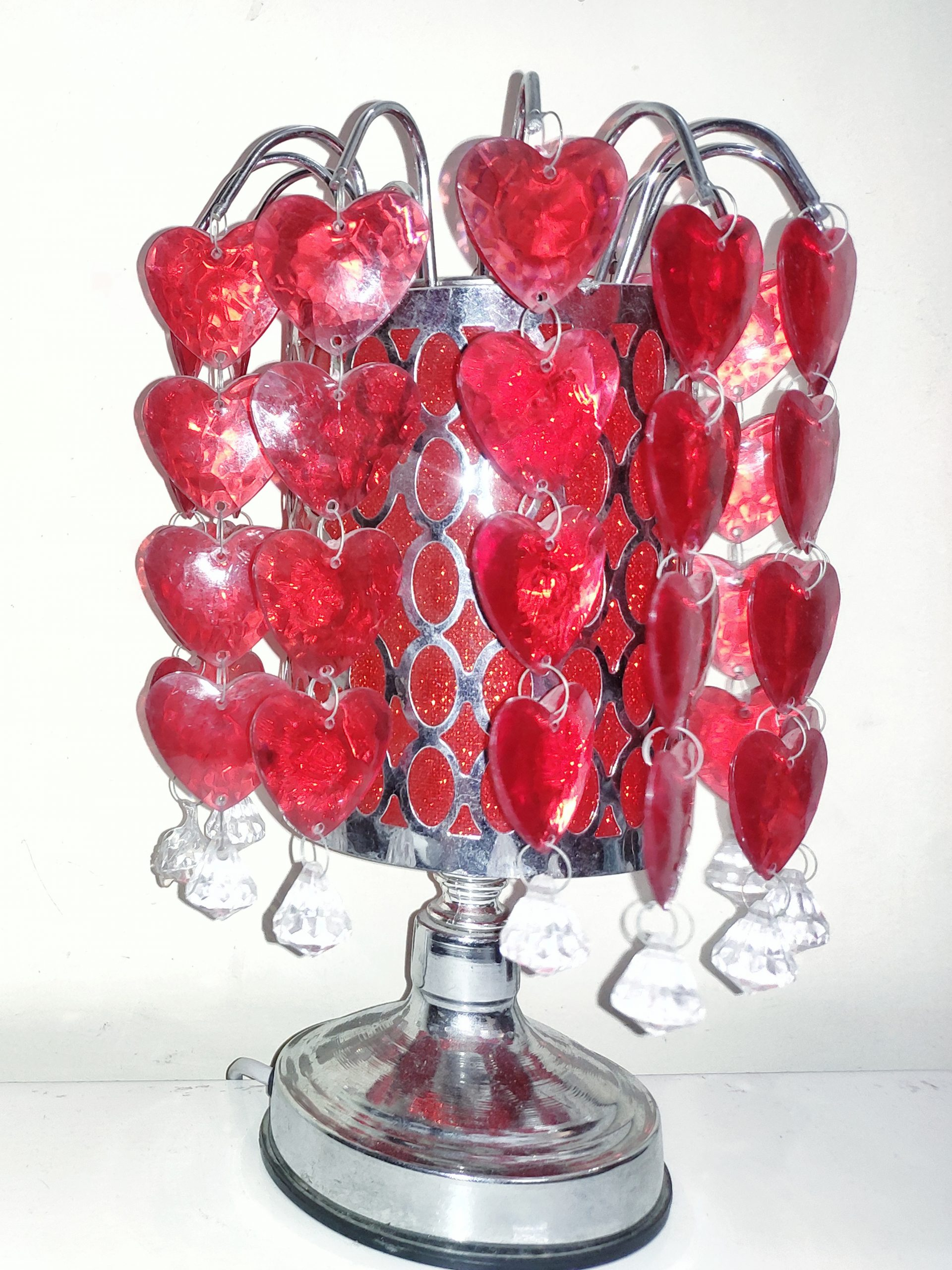 Red heart lamp on a white table