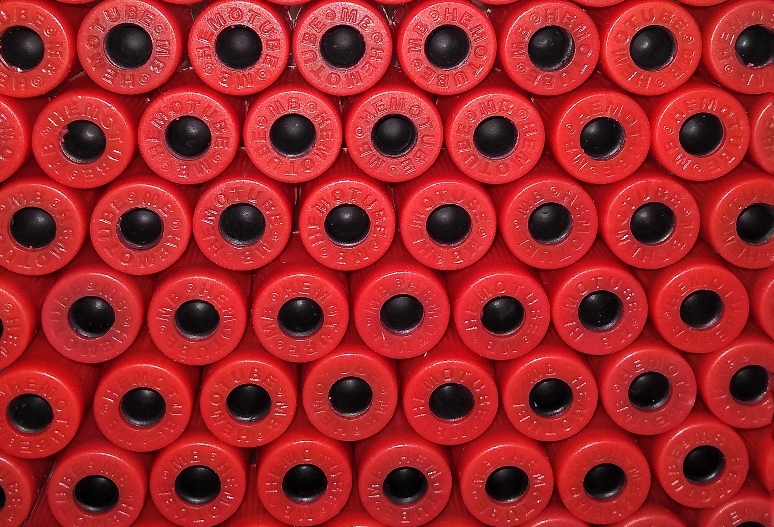 Red vacutainers in a pattern